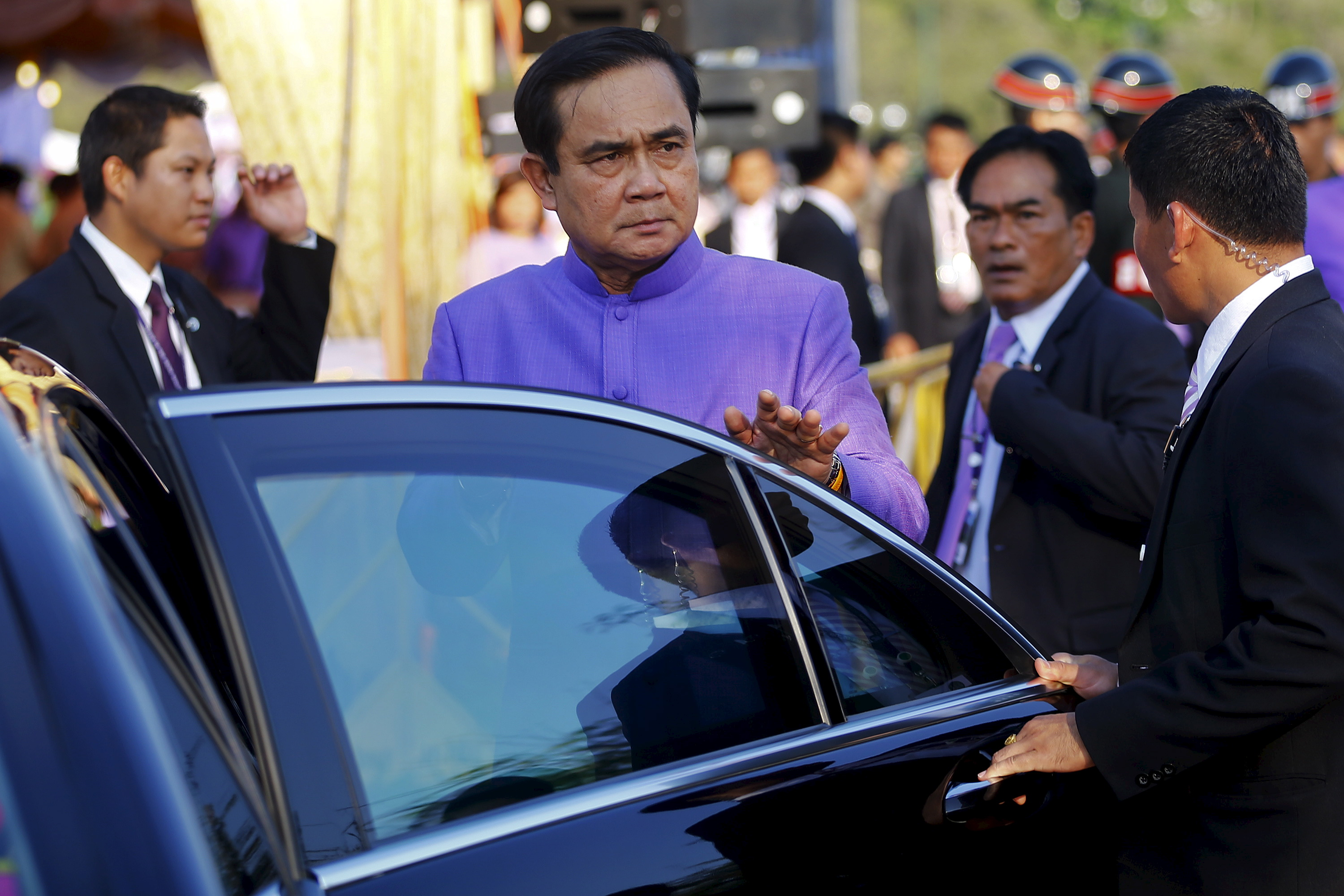 Thailand's Prime Minister Prayuth Chan-ocha gets in his car after the merit-making ceremony on the occasion of Princess Maha Chakri Sirindhorn's birthday at Sanam Luang in Bangkok on April 2, 2015