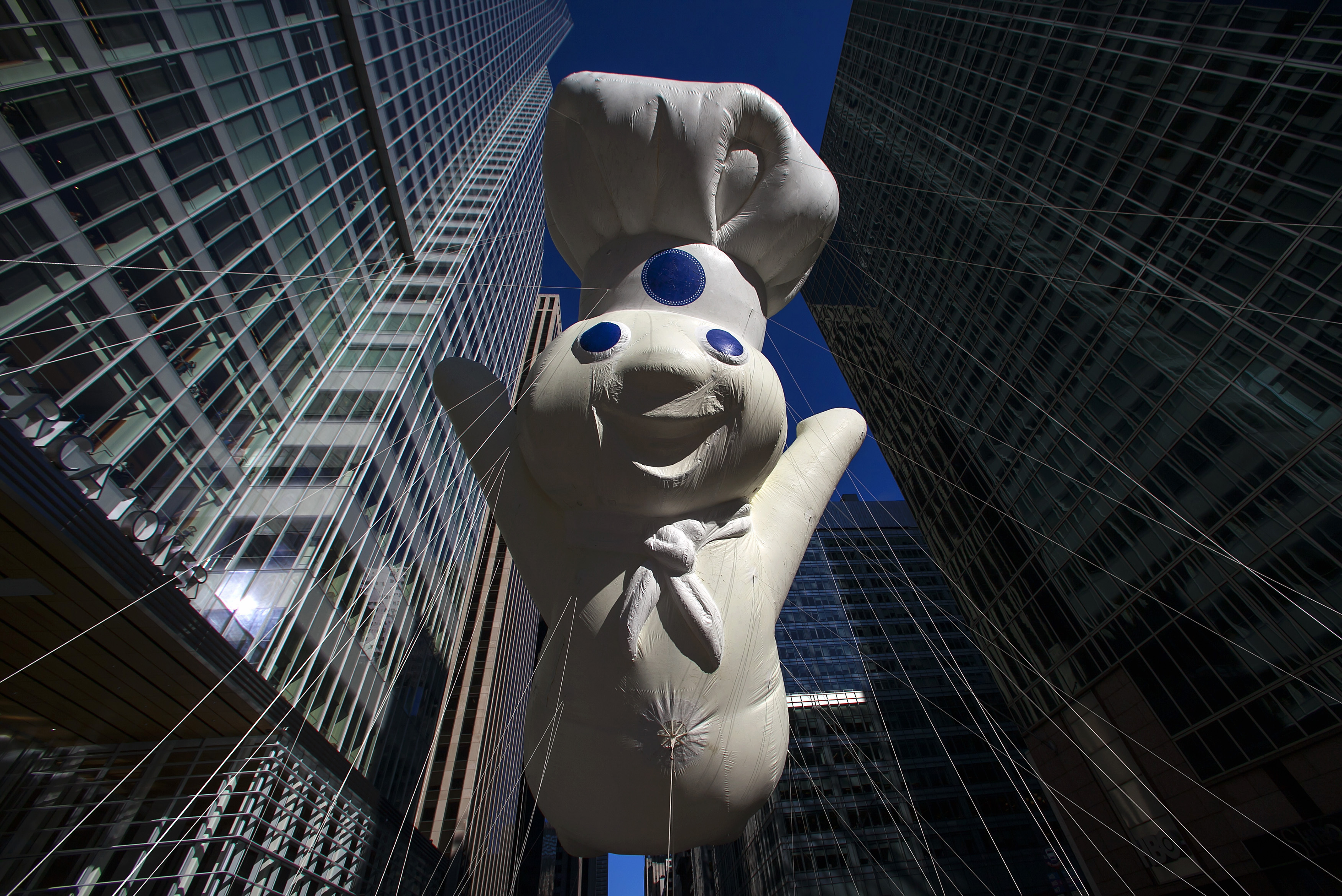 A Pillsbury Doughboy balloon float at the 87th Macy's Thanksgiving Day Parade in New York November 28, 2013