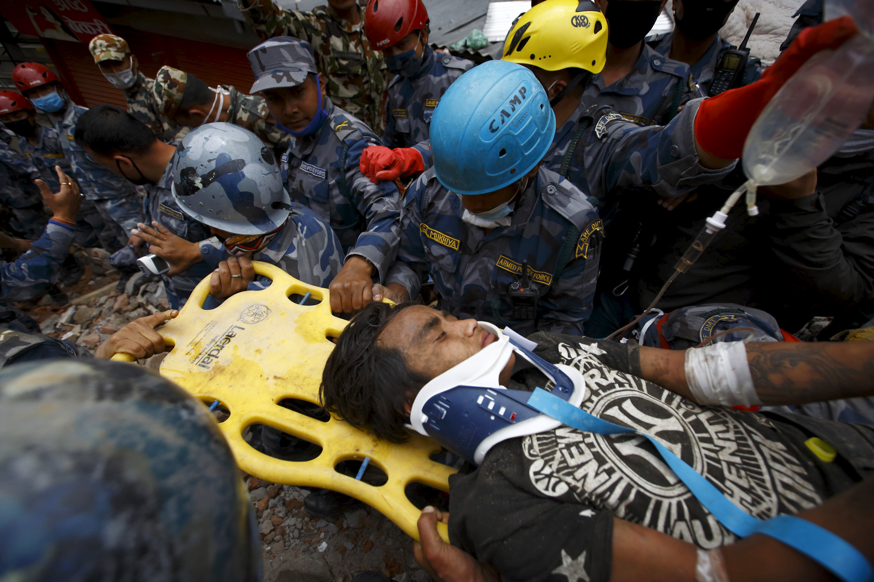 Earthquake survivor Pemba Tamang, 18, is rescued by the Armed Police Force from the collapsed Hilton Hotel, a result of an earthquake in Kathmandu, Nepal April 30, 2015