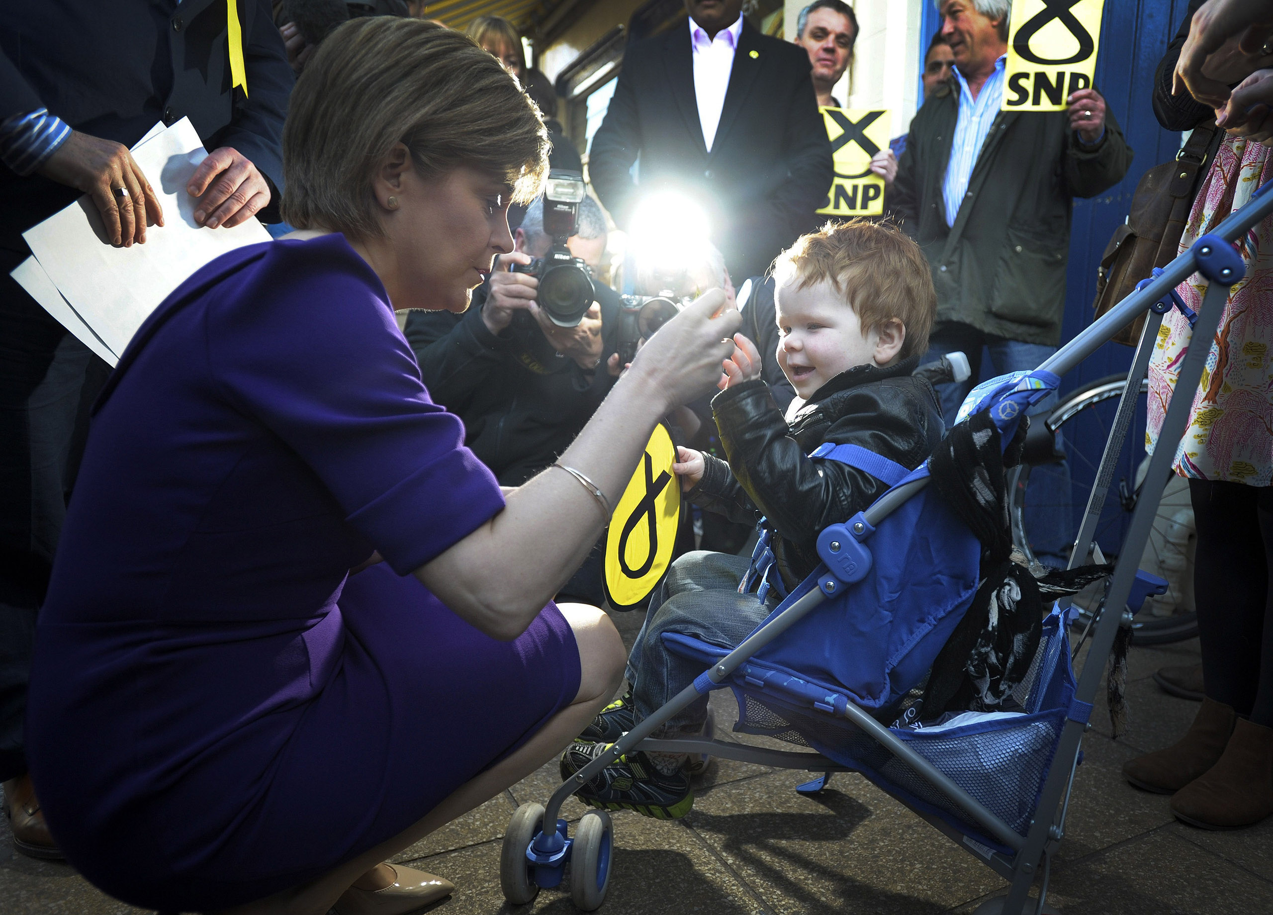 SNP leader Nicola Sturgeon greets a toddler as she campaigns in Edinburgh.