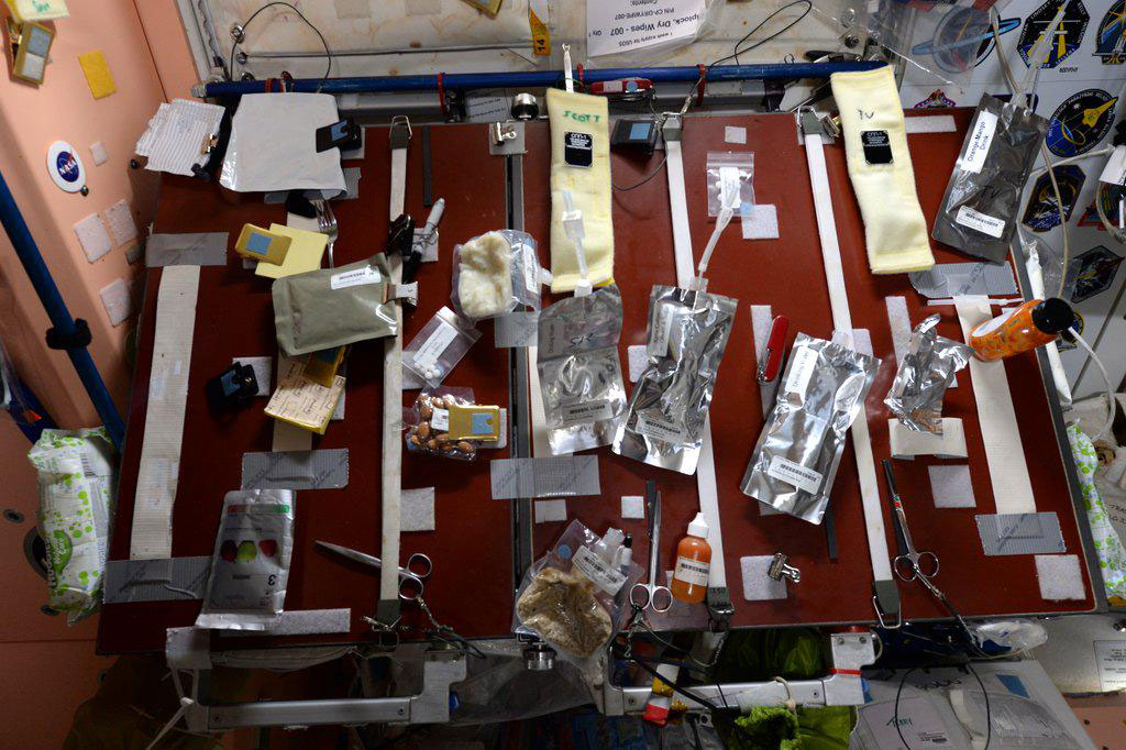 """""""Looks messy, but it's functional. Our #food table on the @space station. What's for breakfast? #YearInSpace"""" - <a href=""""https://twitter.com/StationCDRKelly/status/585798595477135362"""" target=""""_blank"""">via Twitter</a> on April 8, 2015"""