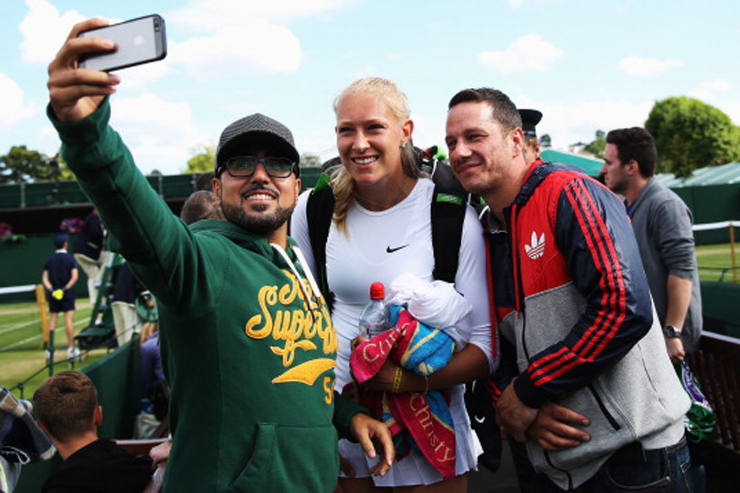 Jocelyn Rae of Great Britain poses for a selfie with fans after her Mixed Doubles first round match with Colin Fleming against Scott Lipsky of the United States and Jie Zheng of China on day five of the Wimbledon Lawn Tennis Championships at the All England Lawn Tennis and Croquet Club on June 27, 2014 in London, England