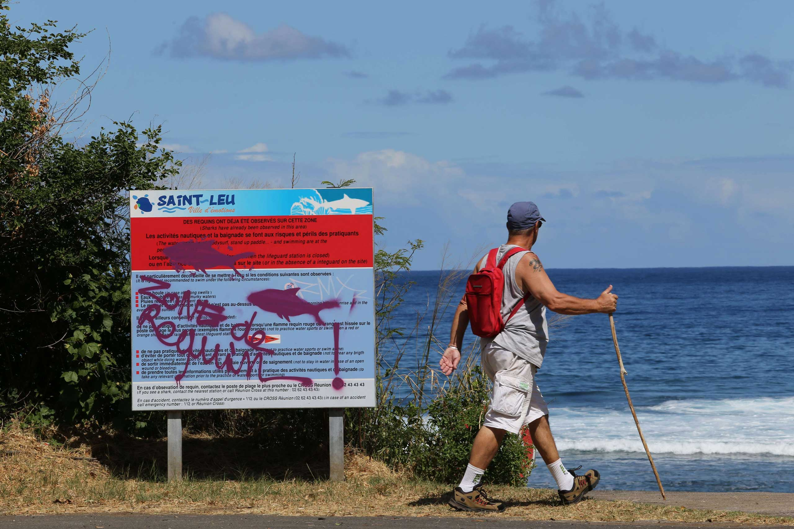A graffiti reading  Shark's area  has been written on an information board, on April 14, 2015 off Saint-Leu, on the western coast of the French Indian Ocean island of La Reunion, two days after a 13-year-old Elio Canestri was attacked and killed by a shark.