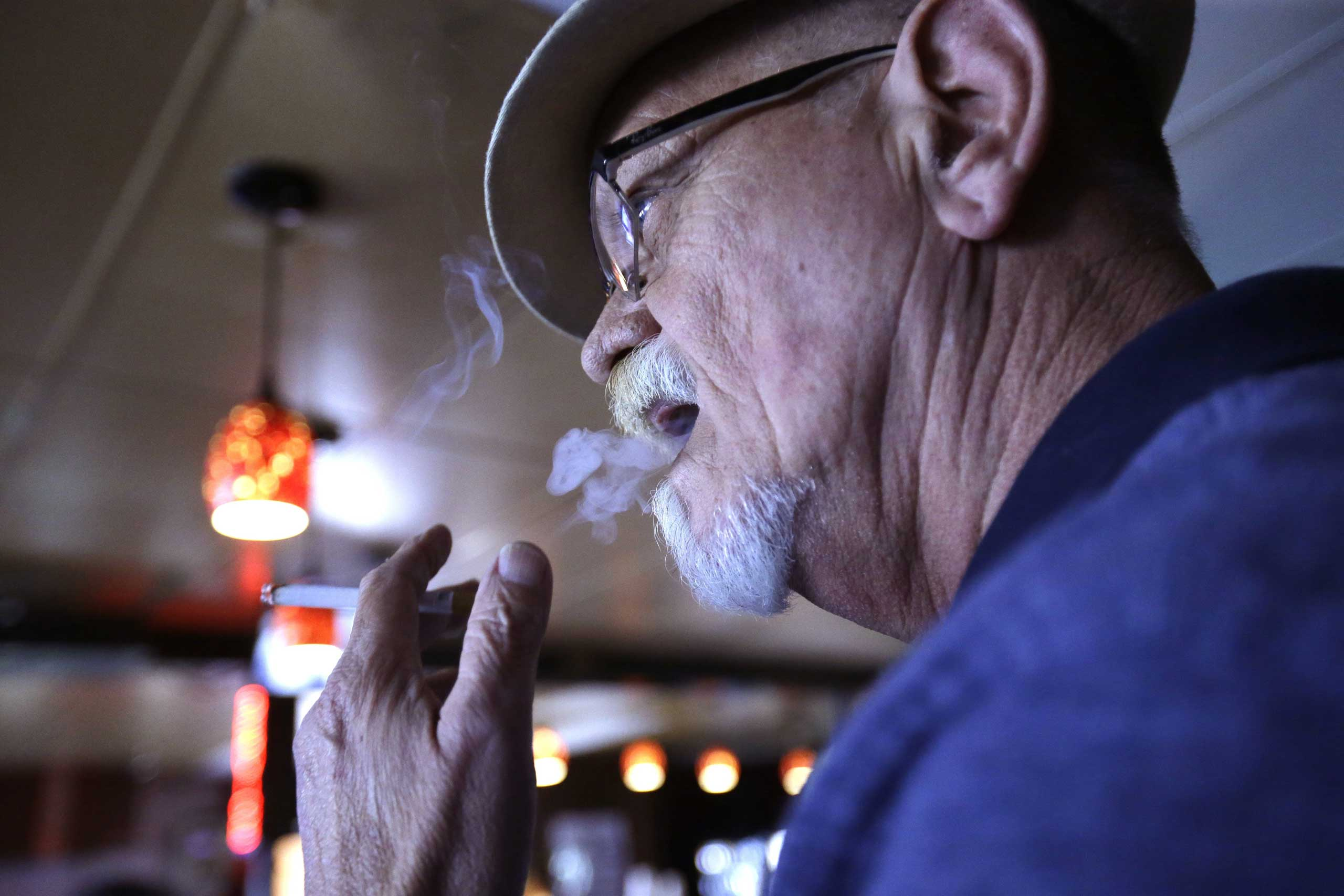 Barry Rutherford smokes a cigarette inside Kajun's Pub in New Orleans April 21, 2015.