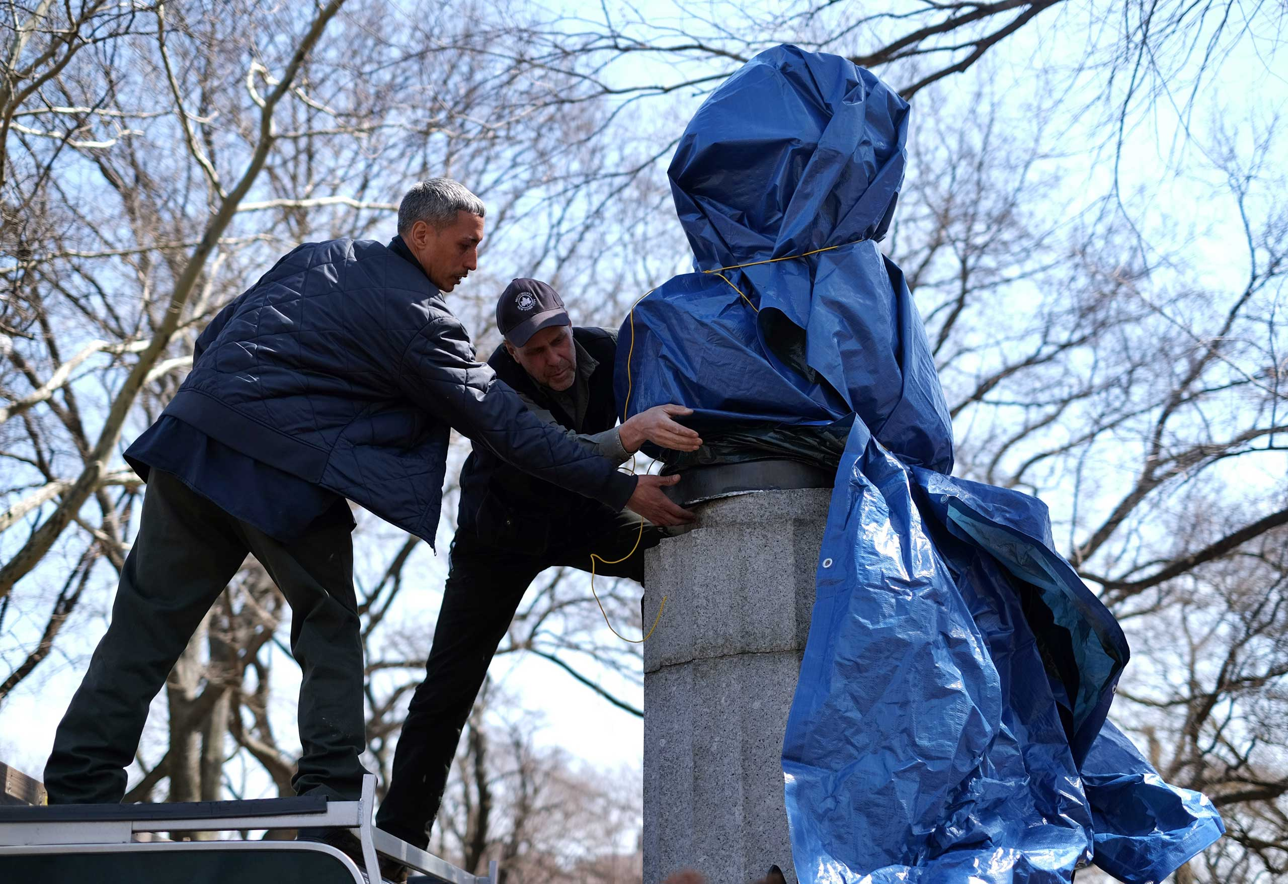 New York City Department of Parks and Recreation employees take down a statue of former National Security Agency (NSA) contractor Edward Snowden at the Fort Greene Park in Brooklyn, N.Y., on Apr. 6, 2015.