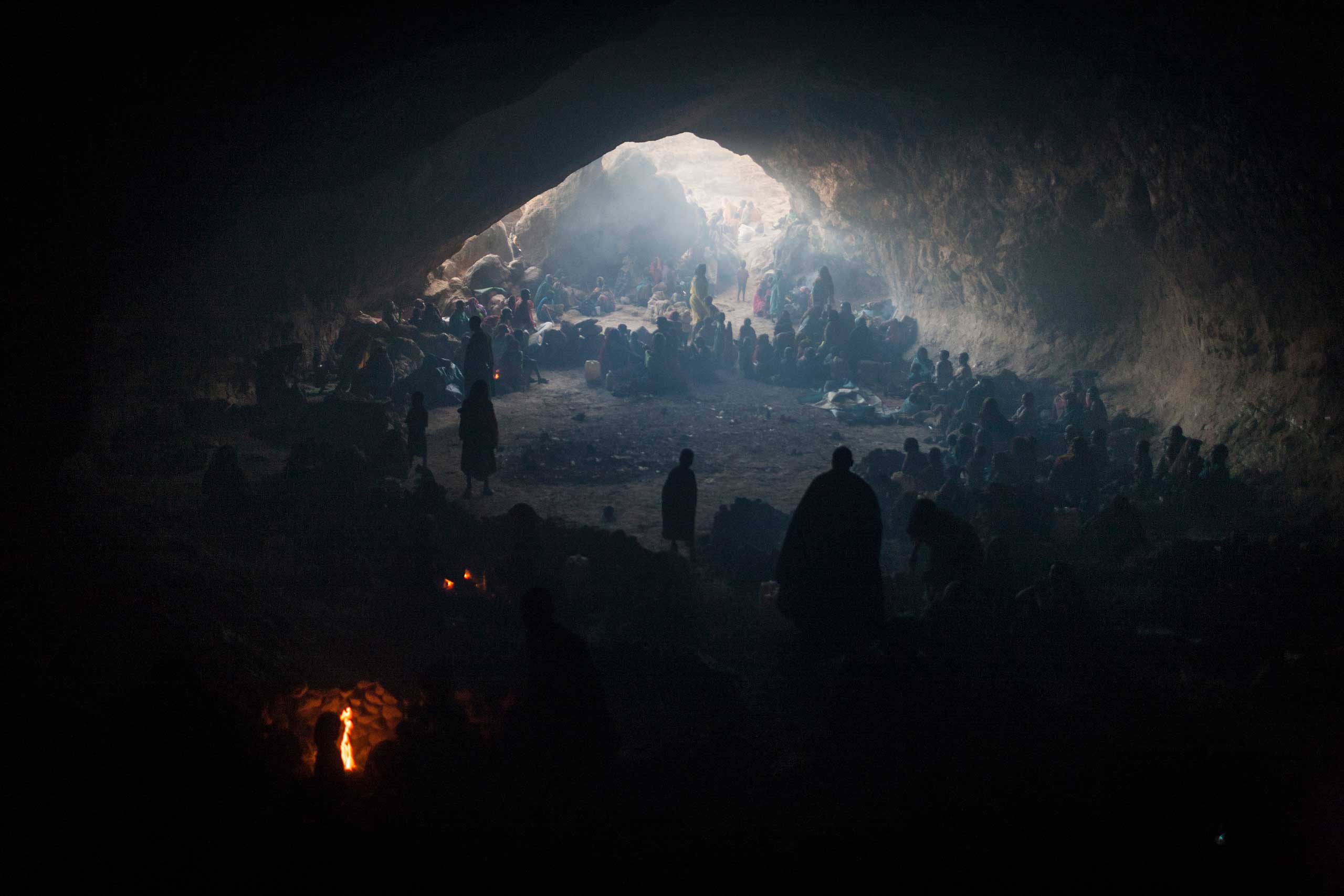 Hundreds of women and children seek shelter in a cave from the bombing by government forces outside of the town of Sarong in Central Darfur, Sudan, March 2, 2015.
