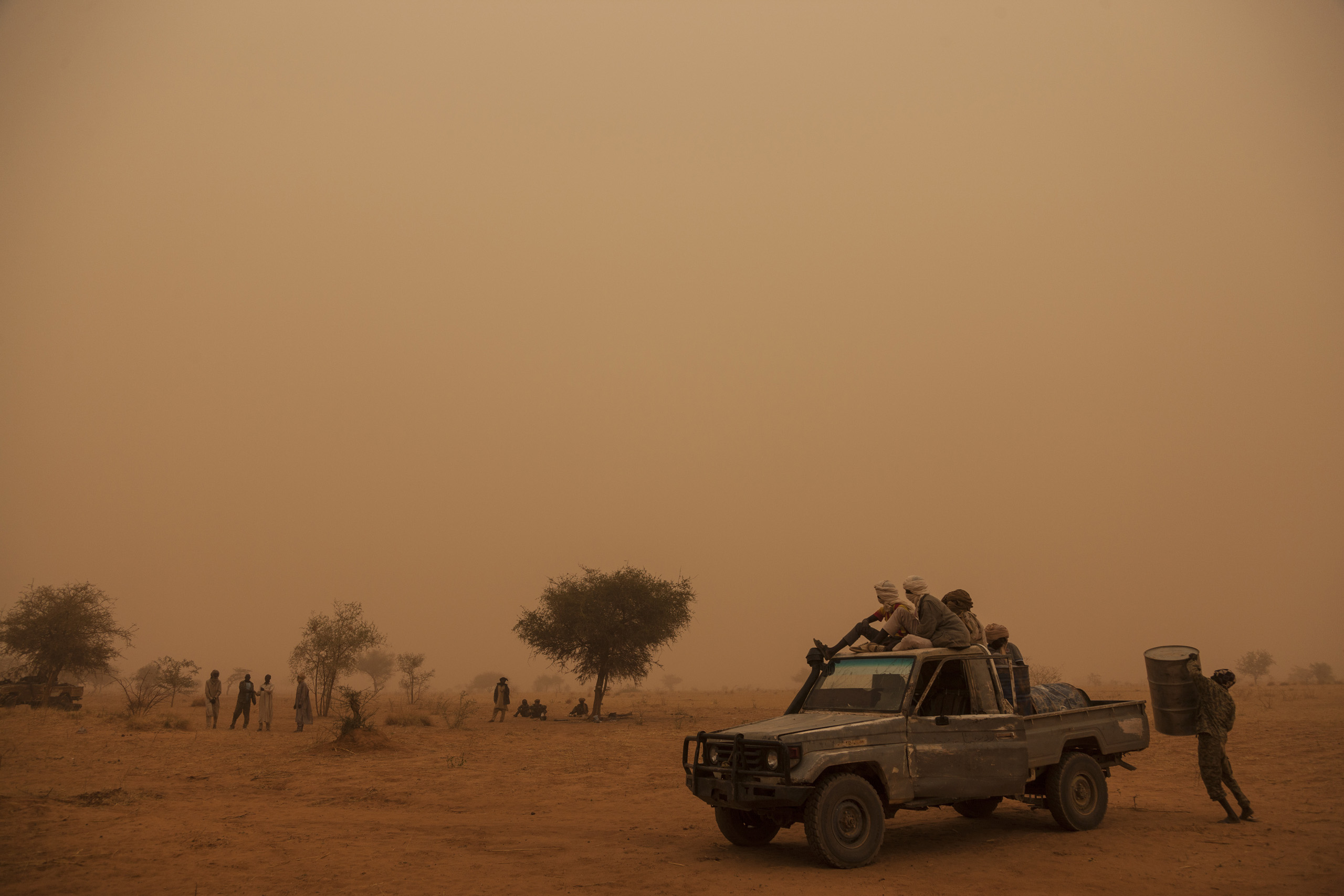 Rebel soldiers from the Sudan Liberation Army – Abdul Wahid (SLA-AW) prepare the truck to go for water in the middle of a sand storm in North Darfur, Sudan, on Feb. 24, 2015.