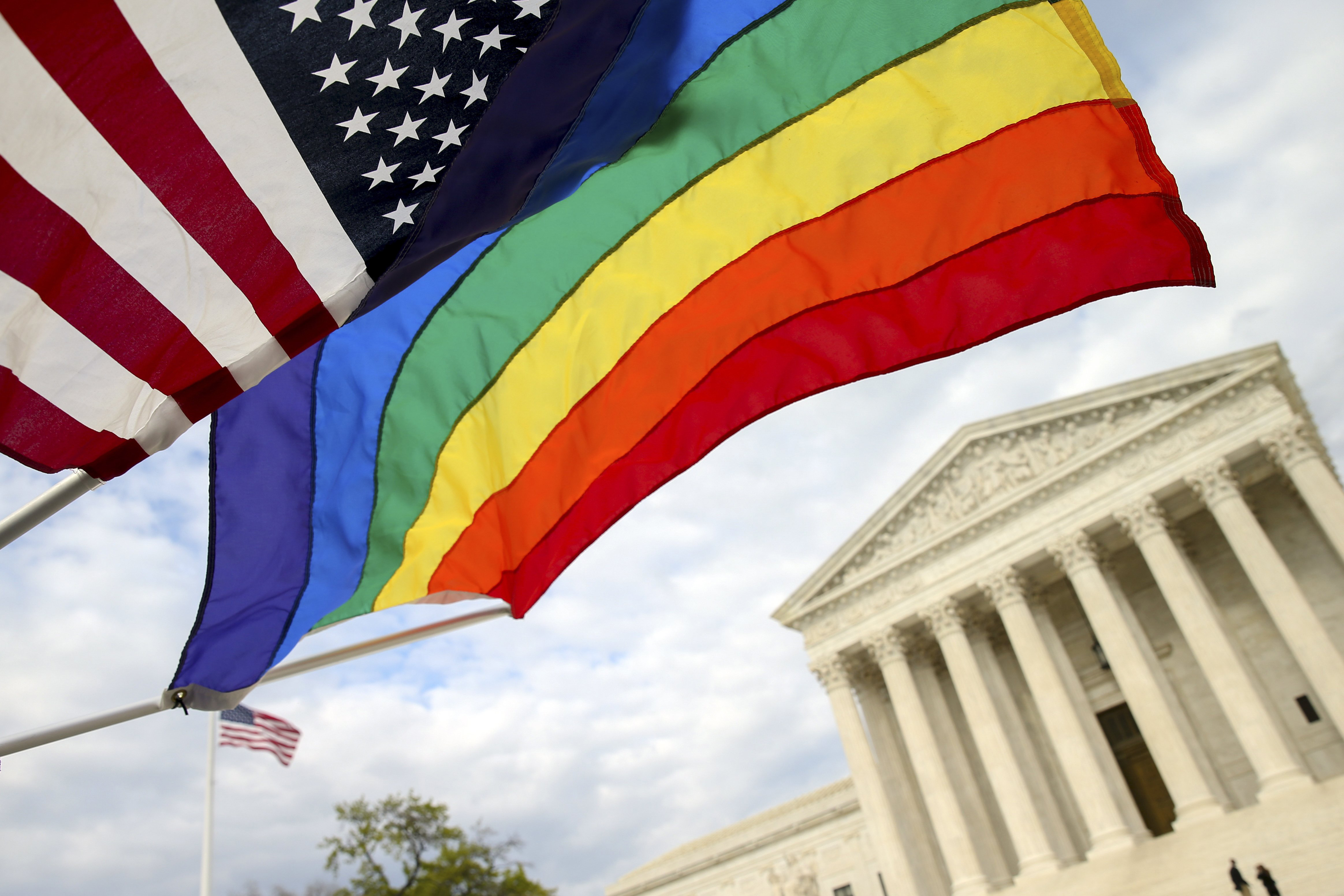 An American flag and a rainbow colored flag flies in front of the Supreme Court in Washington, April 27, 2015, as the Supreme Court is scheduled to hear arguments on the constitutionality of state bans on same-sex marriage on Tuesday.