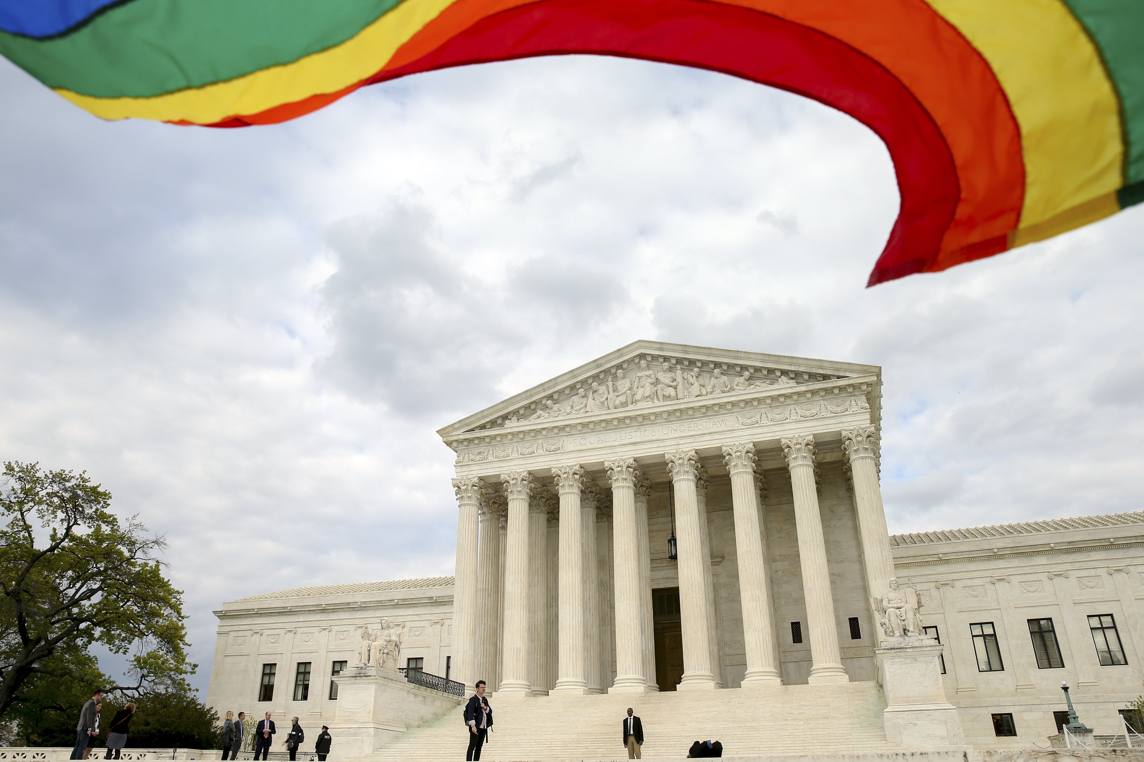 A rainbow colored flag flies in front of the Supreme Court in Washington, April 27, 2015, as the Supreme Court is scheduled to hear arguments on the constitutionality of state bans on same-sex marriage on Tuesday.