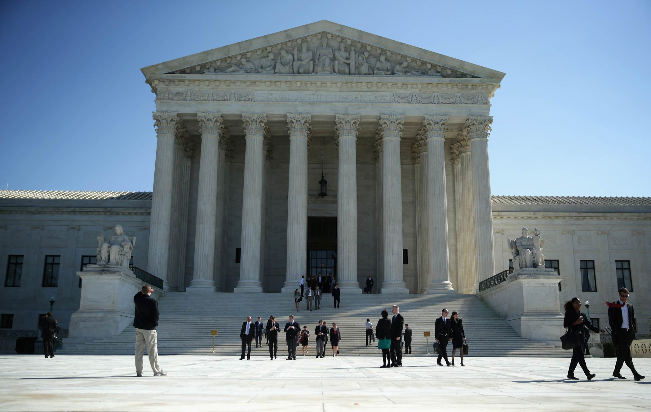 People come out from the U.S. Supreme Court on Oct. 6, 2014 in Washington, DC.