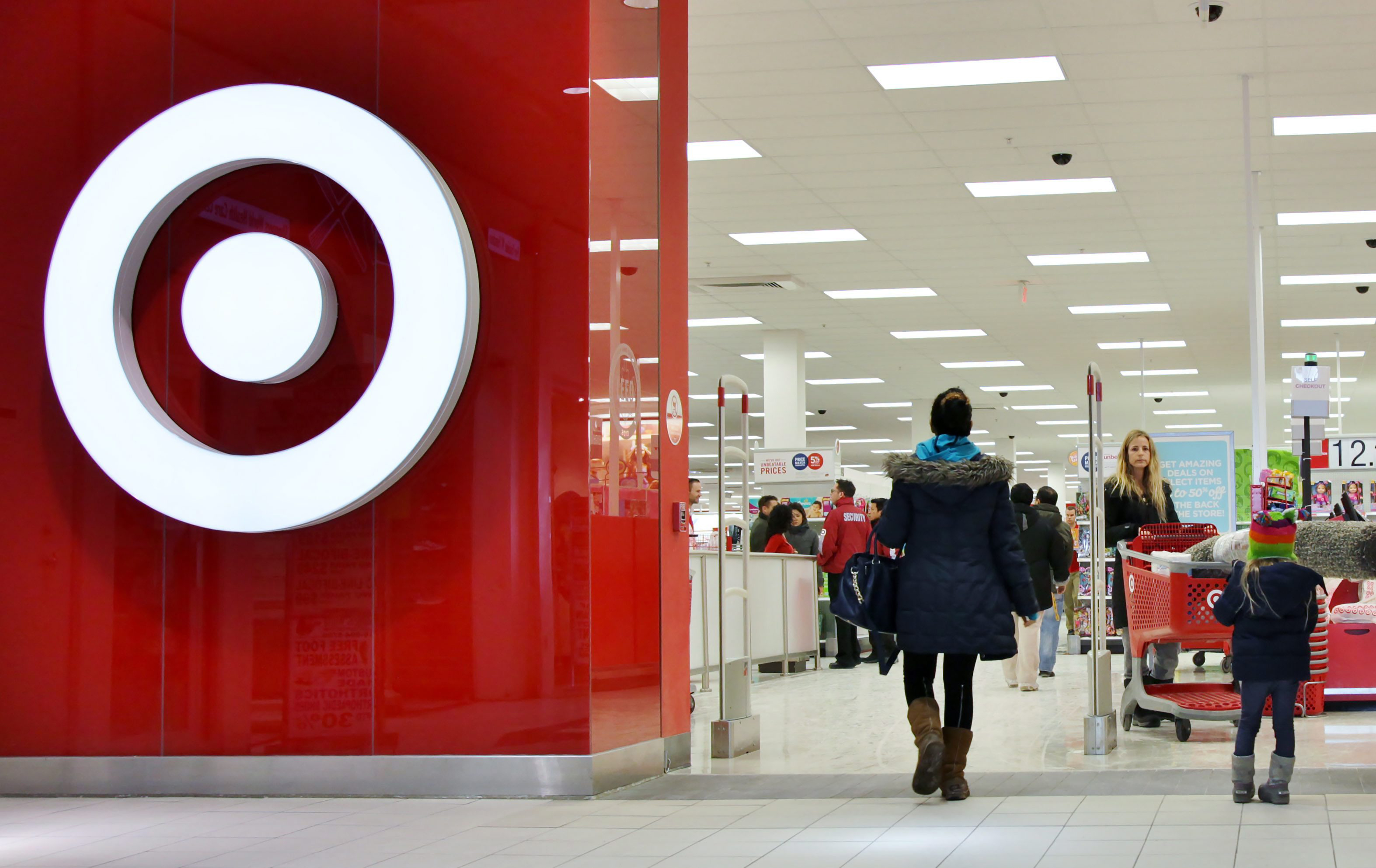 Shoppers enter a Target store in Toronto on Jan. 15, 2015.