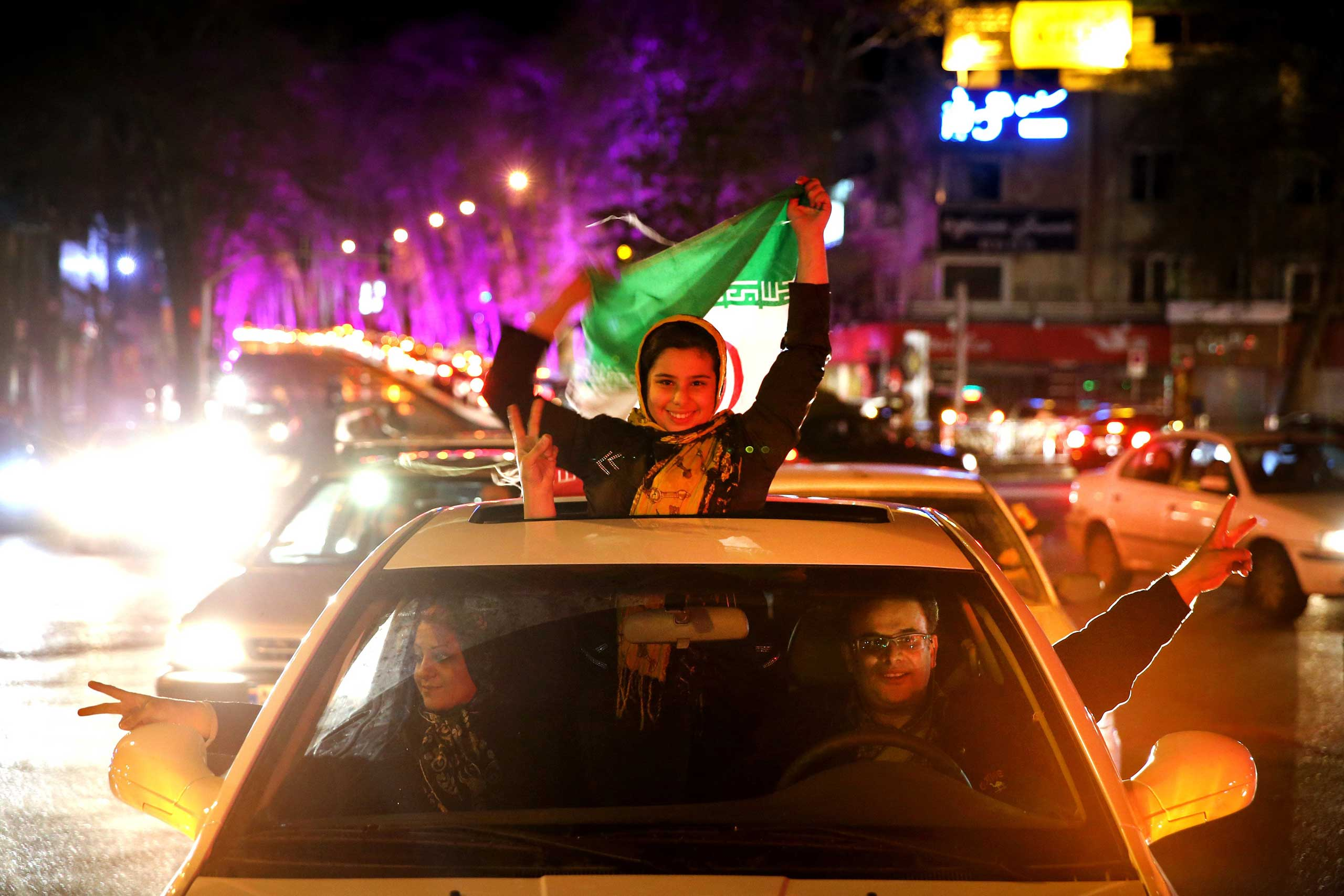Iranians celebrate Iran's nuclear agreement with world powers on a street in northern Tehran, Iran, on Apr. 2, 2015.