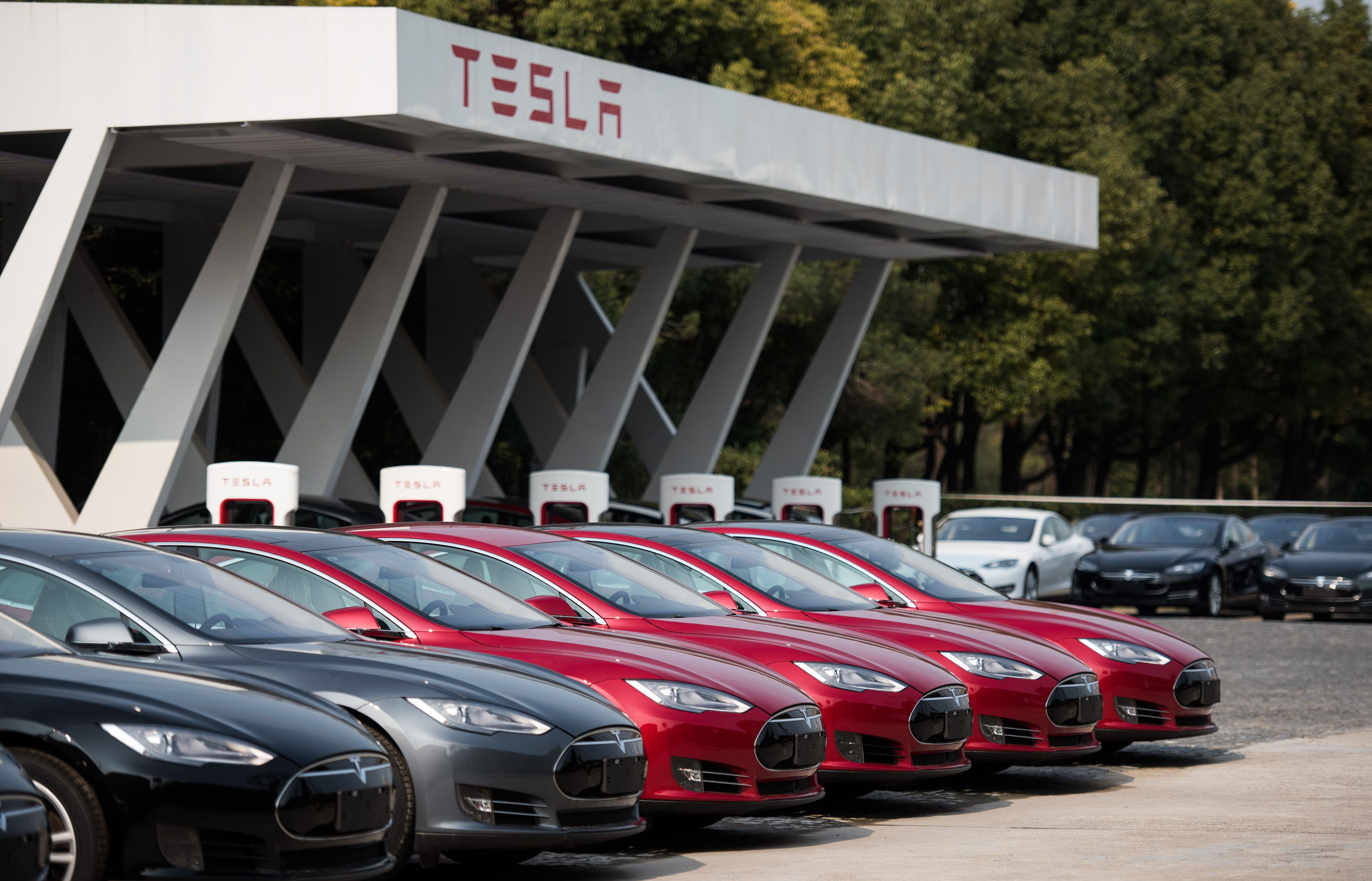 Tesla Model S vehicles parked outside a car dealership in Shanghai on March 17, 2015.