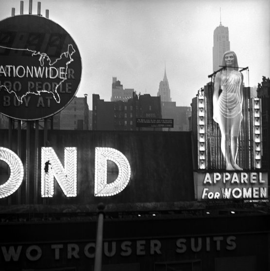 USA. New York City. Times Square. Clothing shop advertisment. 1950