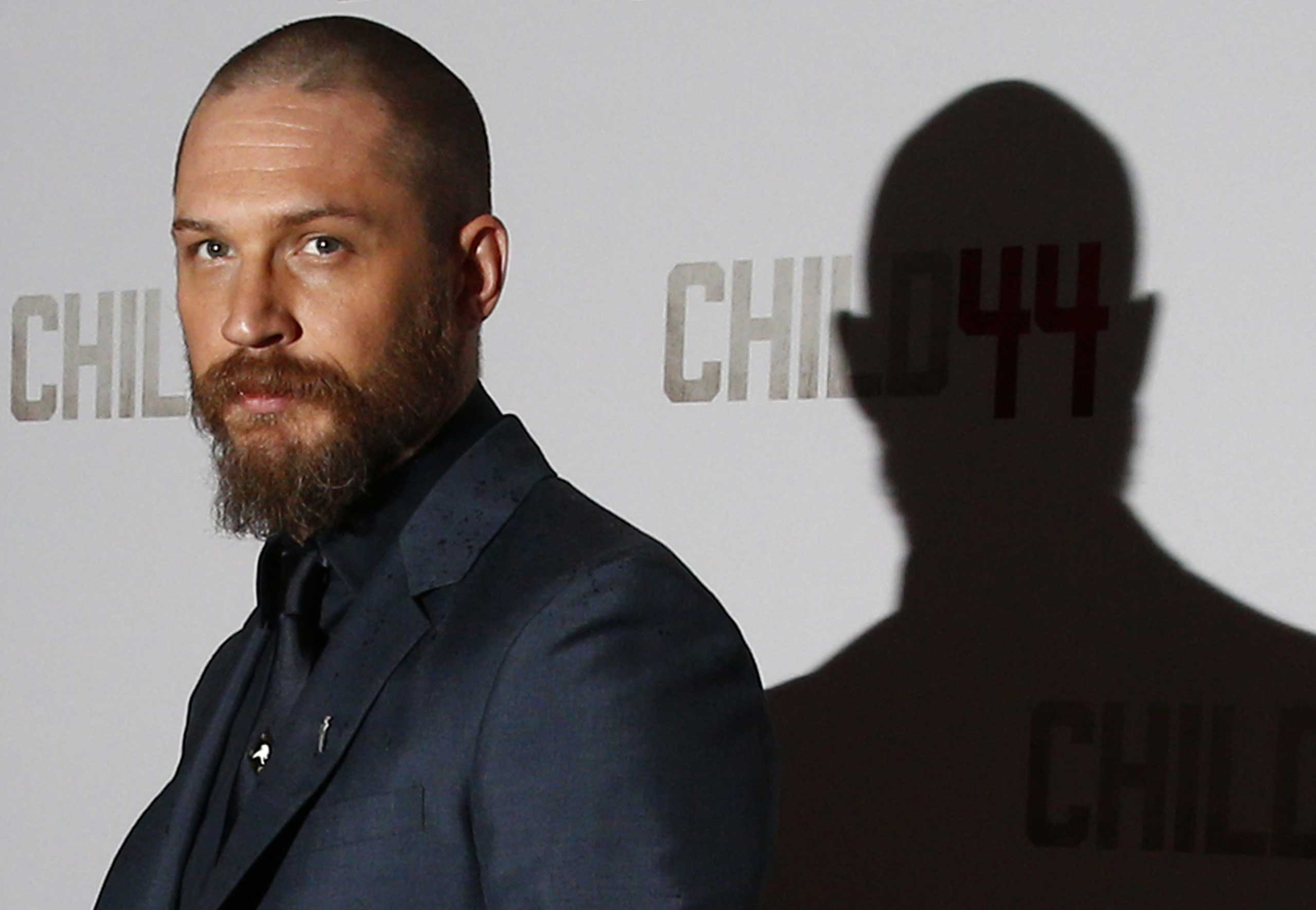 British actor Tom Hardy poses for photographers on the red carpet ahead of the UK premiere of  Child 44  in central London on April 16, 2015.