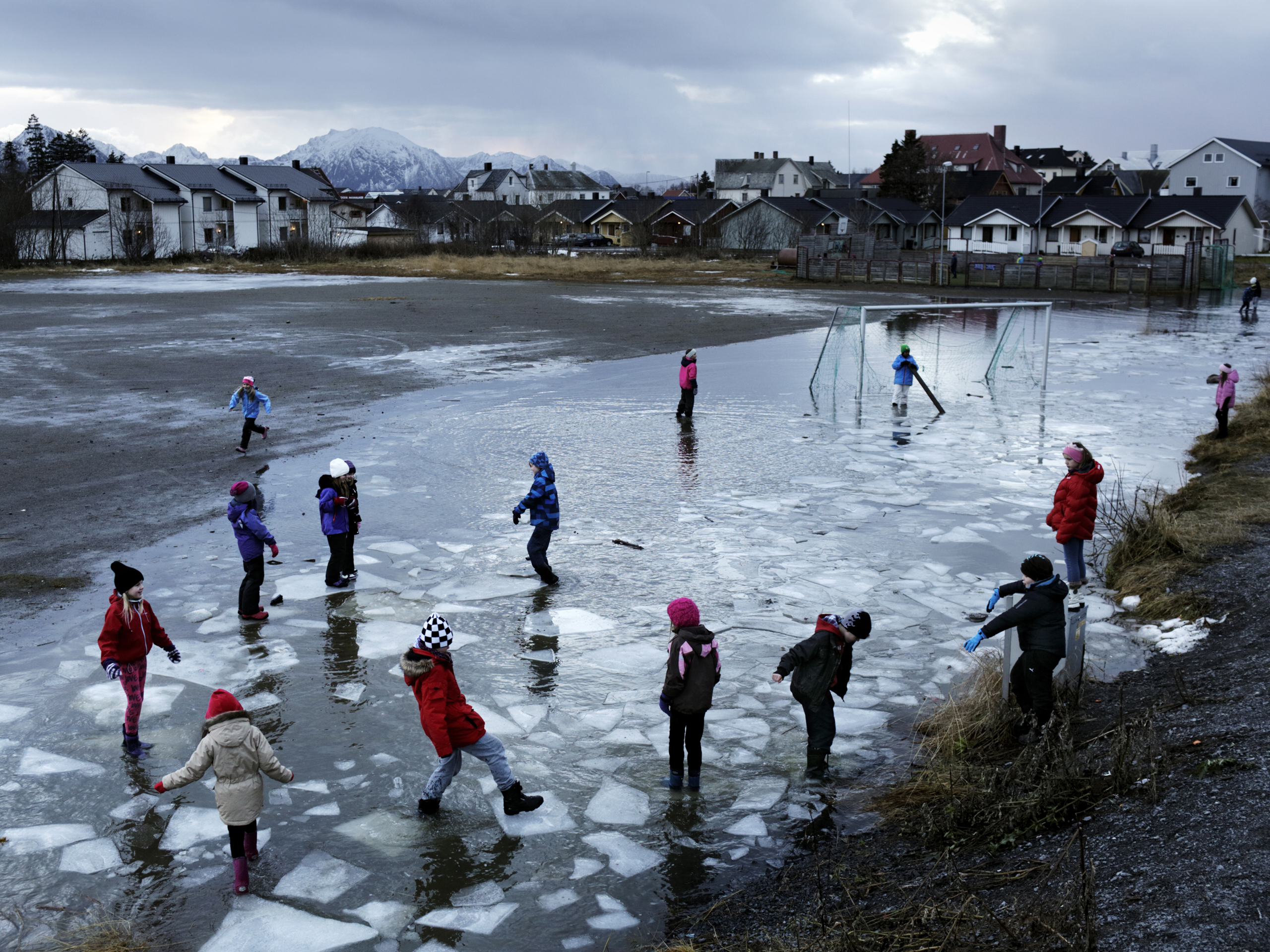 In Melbu, children play on ice floes in the schoolyard. 2012, Vesterålen, Norway.