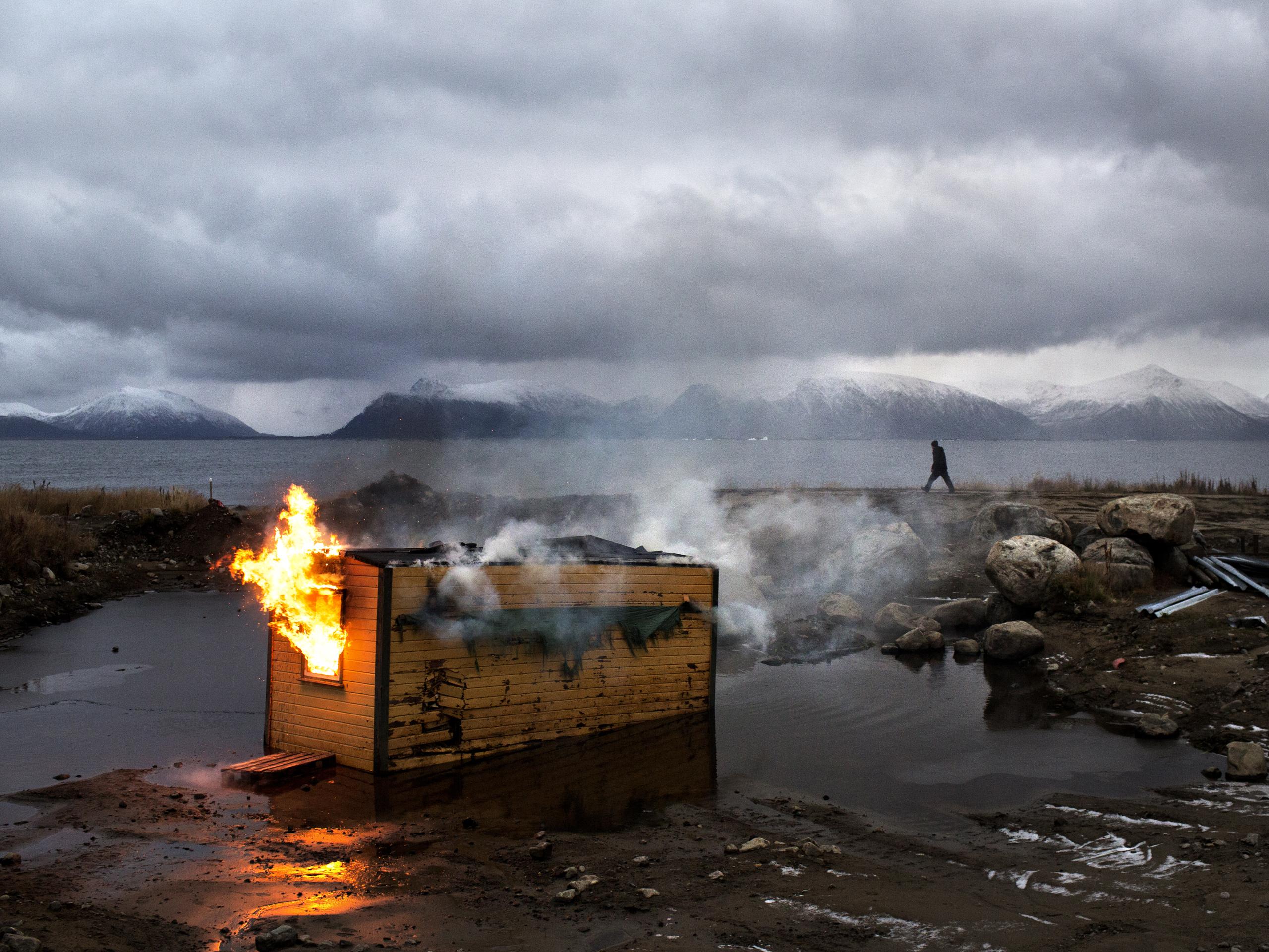 Old barracks set on fire to make way for a car racing track. Village of Klo. 2012, Vesterålen, Norway.