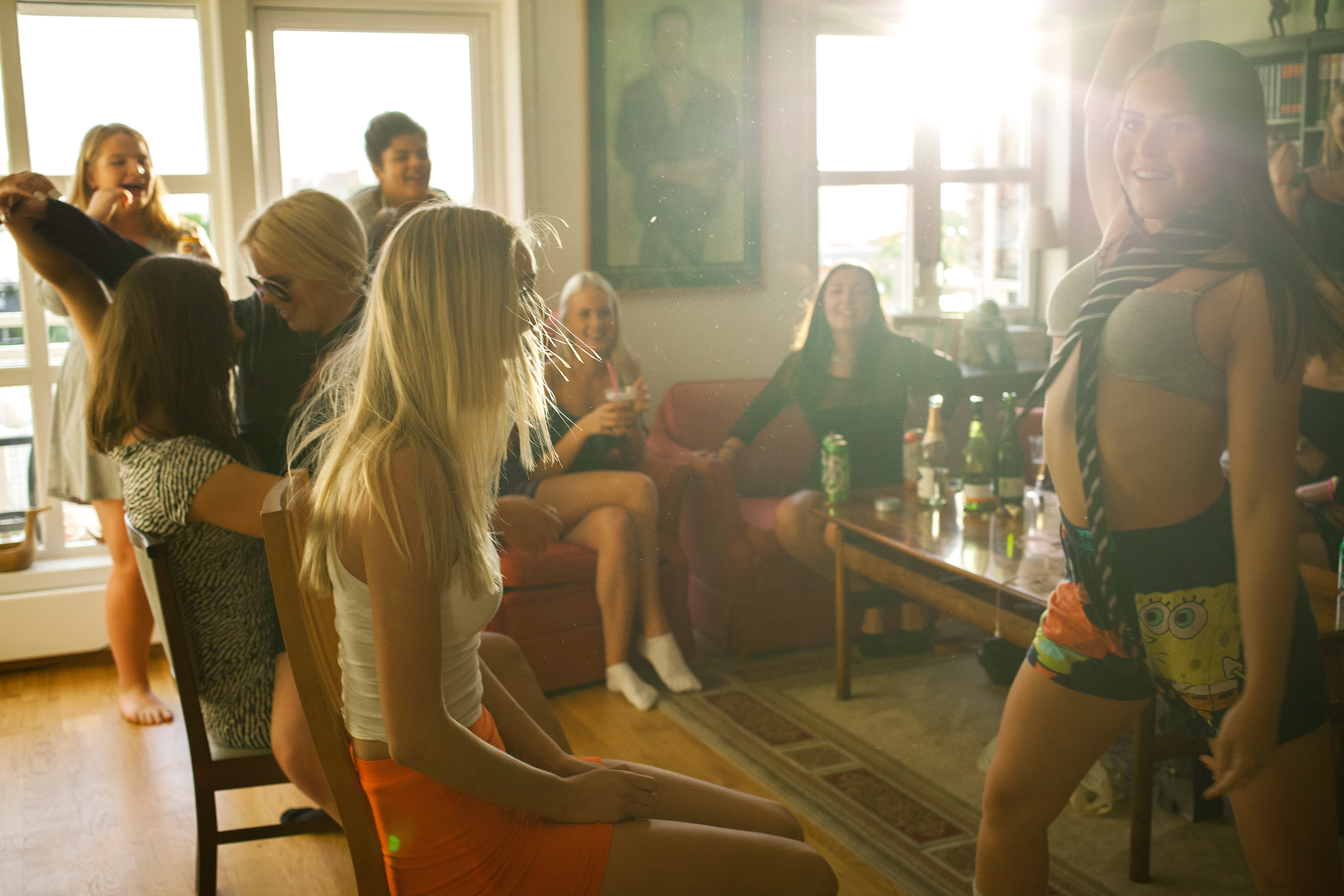 Ingrid and Ragnhild celebrating their 18th birthdays. Dressed in Ragnhild's brother's clothes, Selma and Mia dedicate a strip show to the two birthday girls.