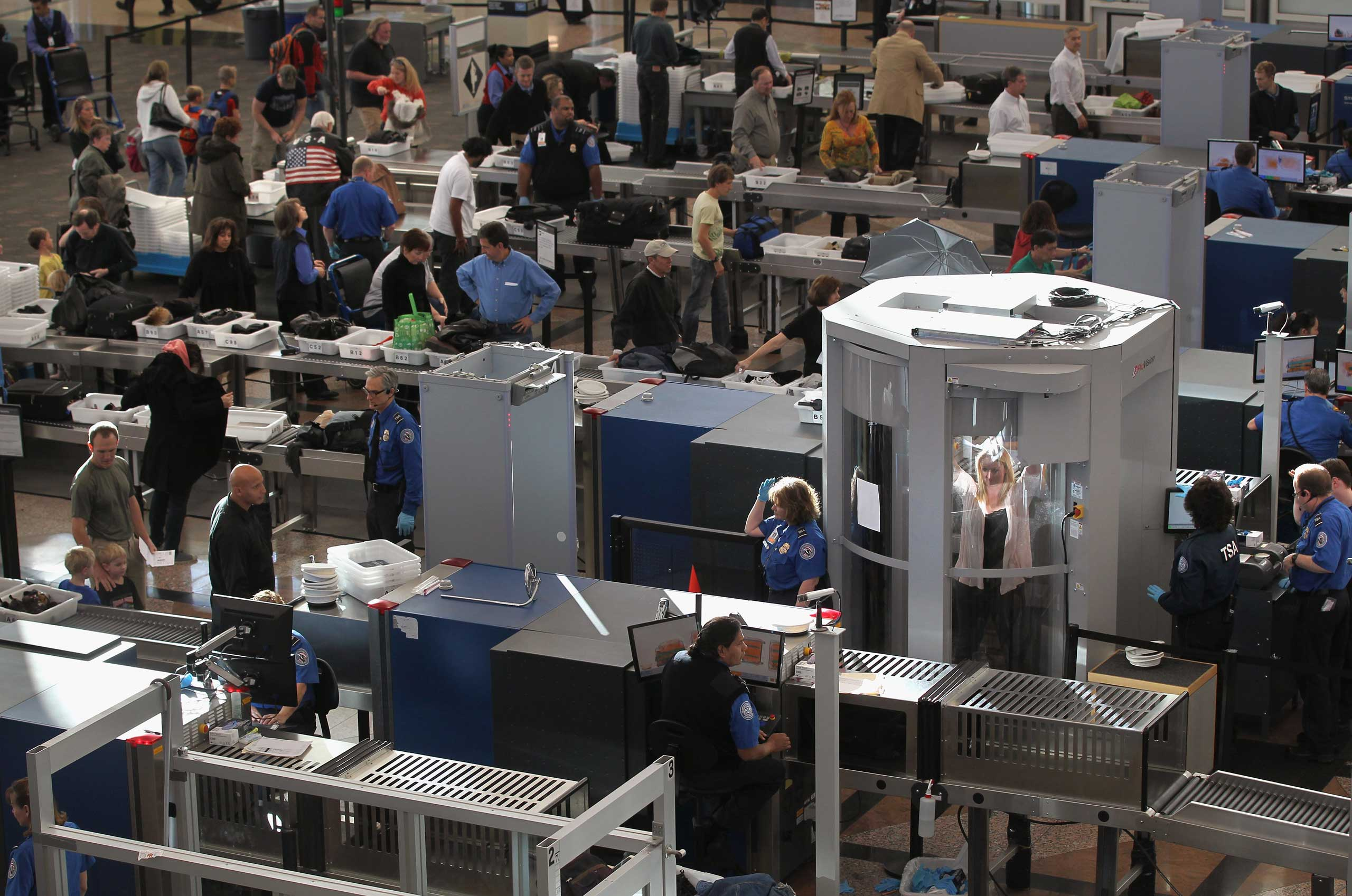 Transportation Security Administration agents screen passengers at Denver International Airport in 2010.