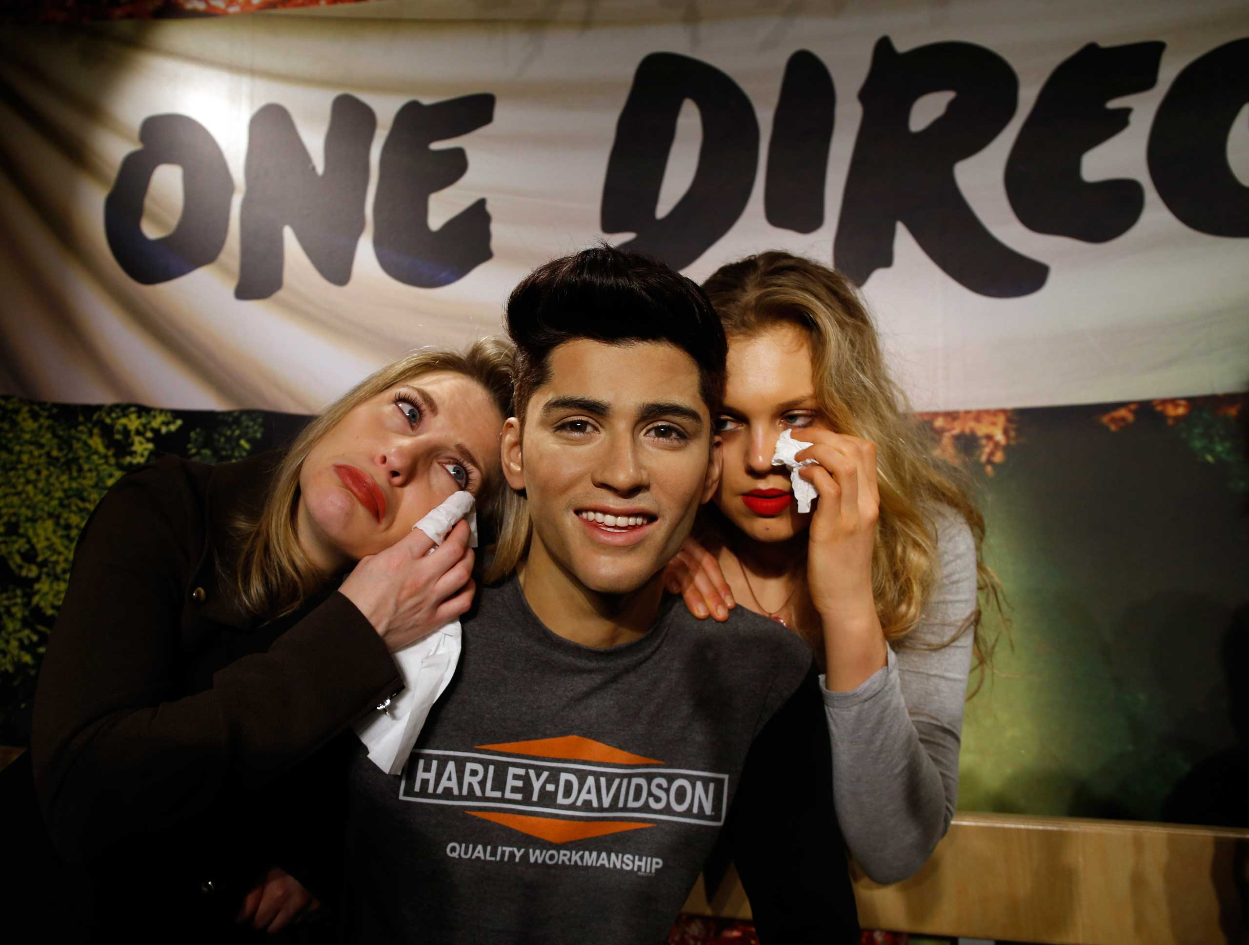 One Direction fans Laura Tokely and Lindsay Ringette wipe away tears following the news of the departure of Zayn Malik from One Direction on March 31, 2015 in London, England.