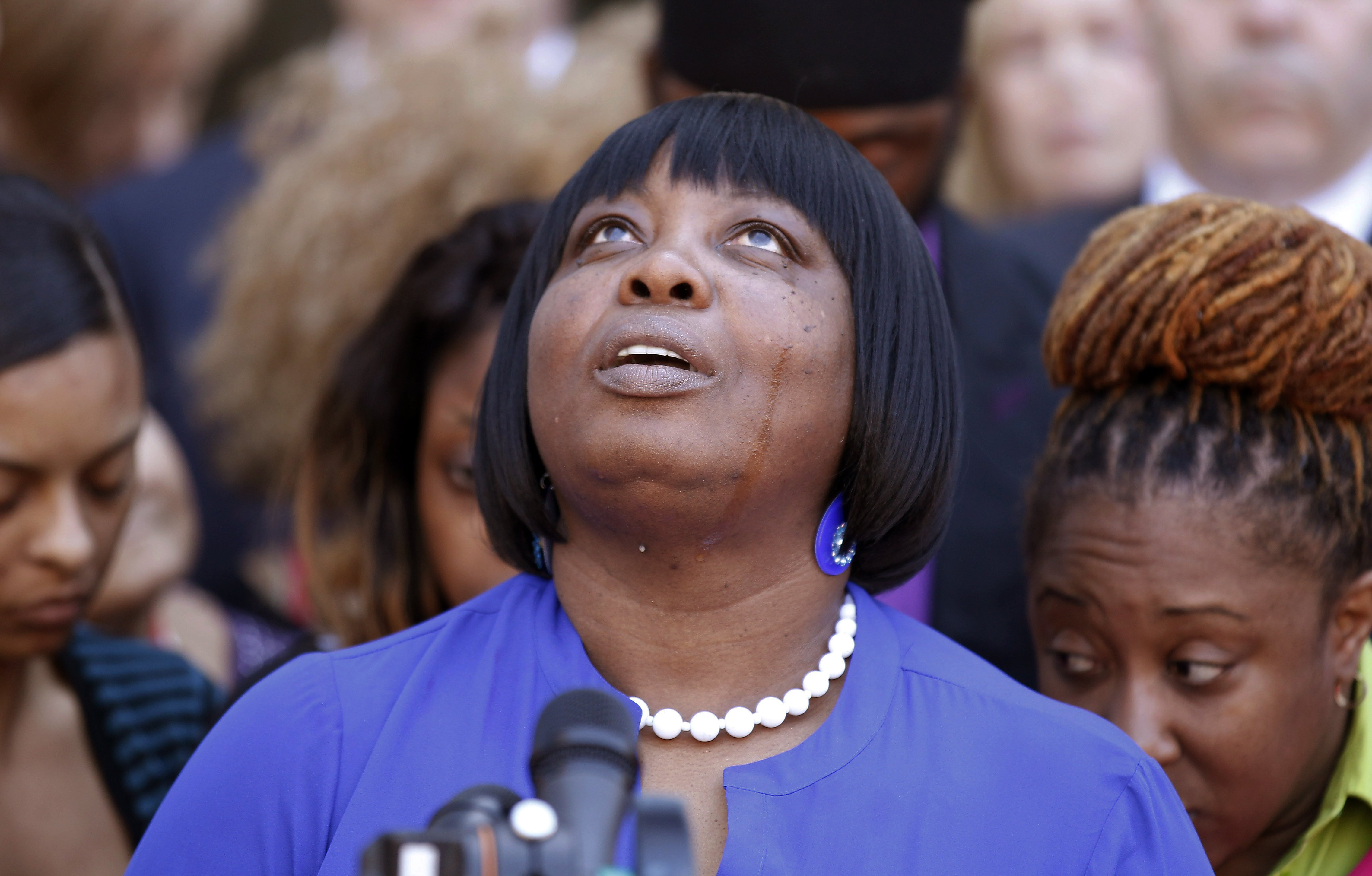 Ursula Ward, mother of shooting victim Odin Lloyd, looks up to the heavens as she talks about her deceased son outside Bristol County Superior Court on April 15, 2015, in Fall River, Mass., after former New England Patriots football player Aaron Hernandez was found guilty of murder in the shooting death of Odin Lloyd.