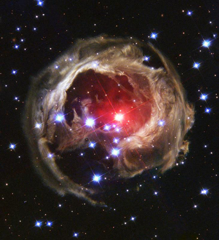<strong>V838 Monocerotis</strong>:                                   This is Hubble's latest view of an expanding halo of light around a distant star, named V838 Monocerotis (V838 Mon) which is about 20,000 light-years away from Earth, placing the star at the outer edge of our Milky Way galaxy. The illumination of interstellar dust comes from the red supergiant star at the middle of the image.                                                                       <i>Image released on March 4, 2004</i>