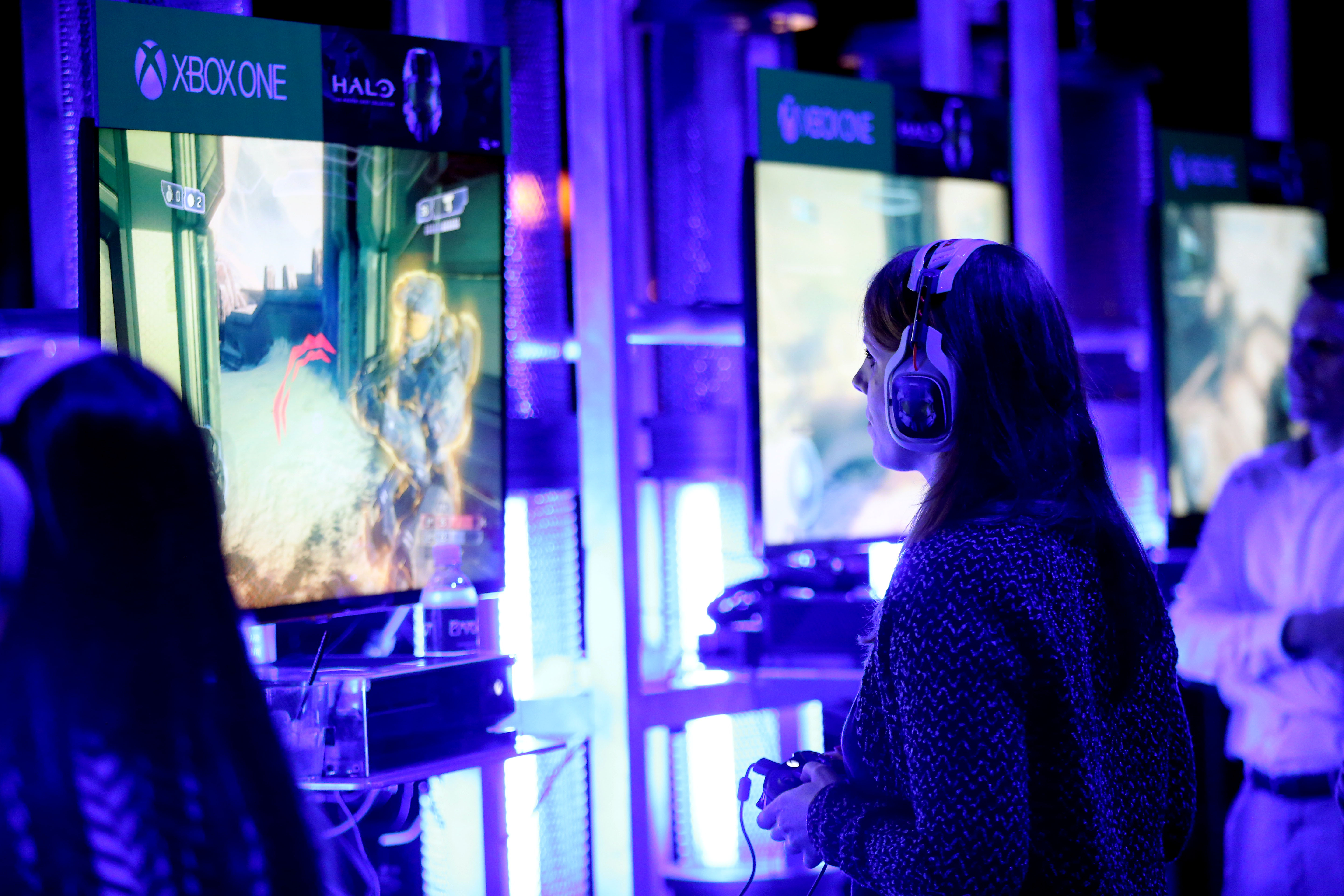 "Xbox fans play games from the popular ""Halo"" franchise at HaloFest at the Avalon Theatre in Los Angeles on Monday, Nov. 10, 2014"