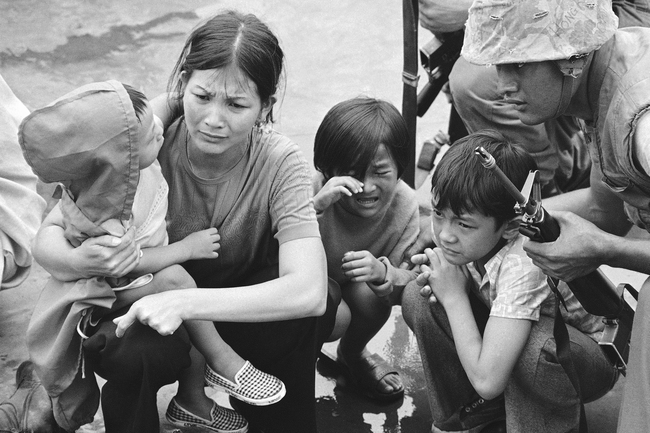 A weeping South Vietnamese mother and her three children are plucked out of Saigon by U.S. Marine helicopters in Vietnam.