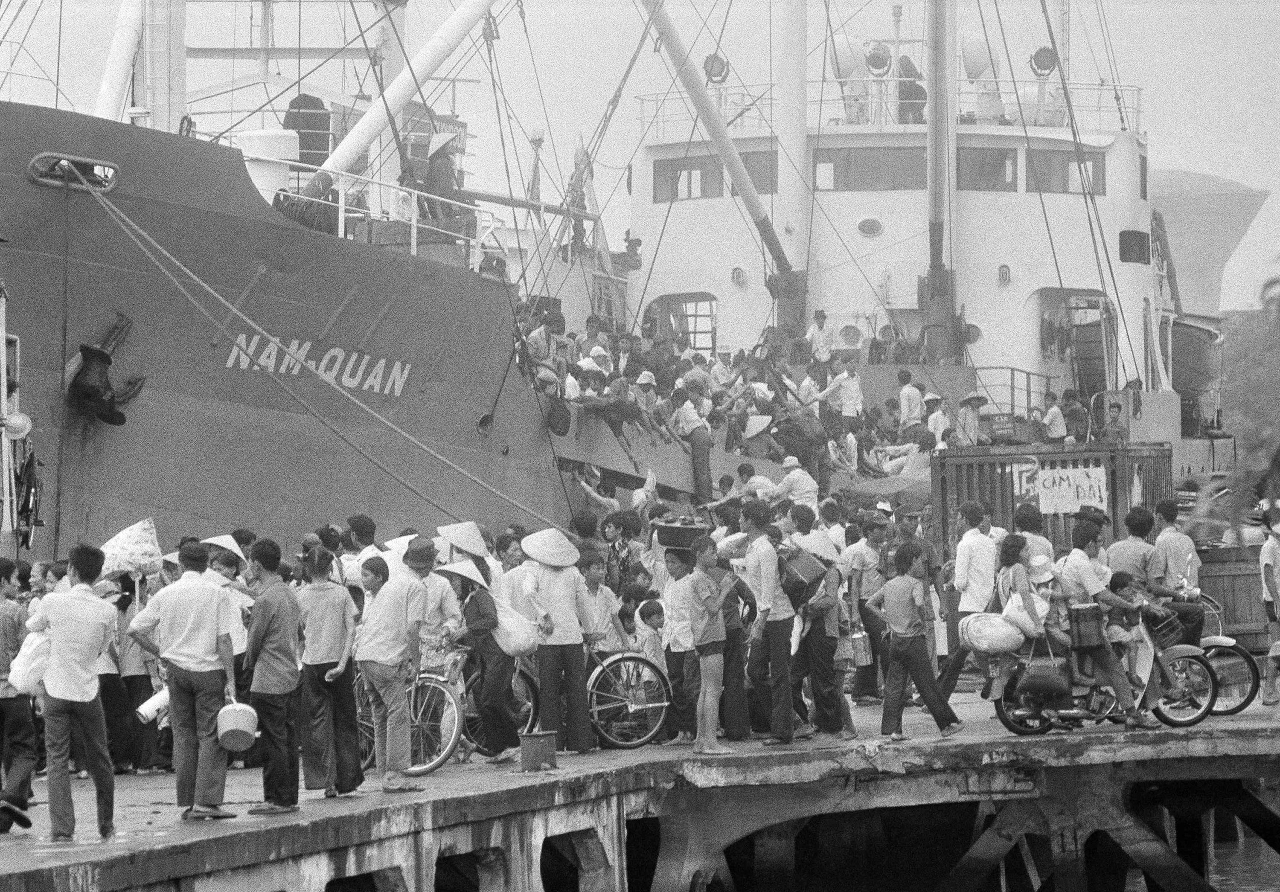 The last Vietnamese evacuees by boat from Saigon waterfront, as troops close in.