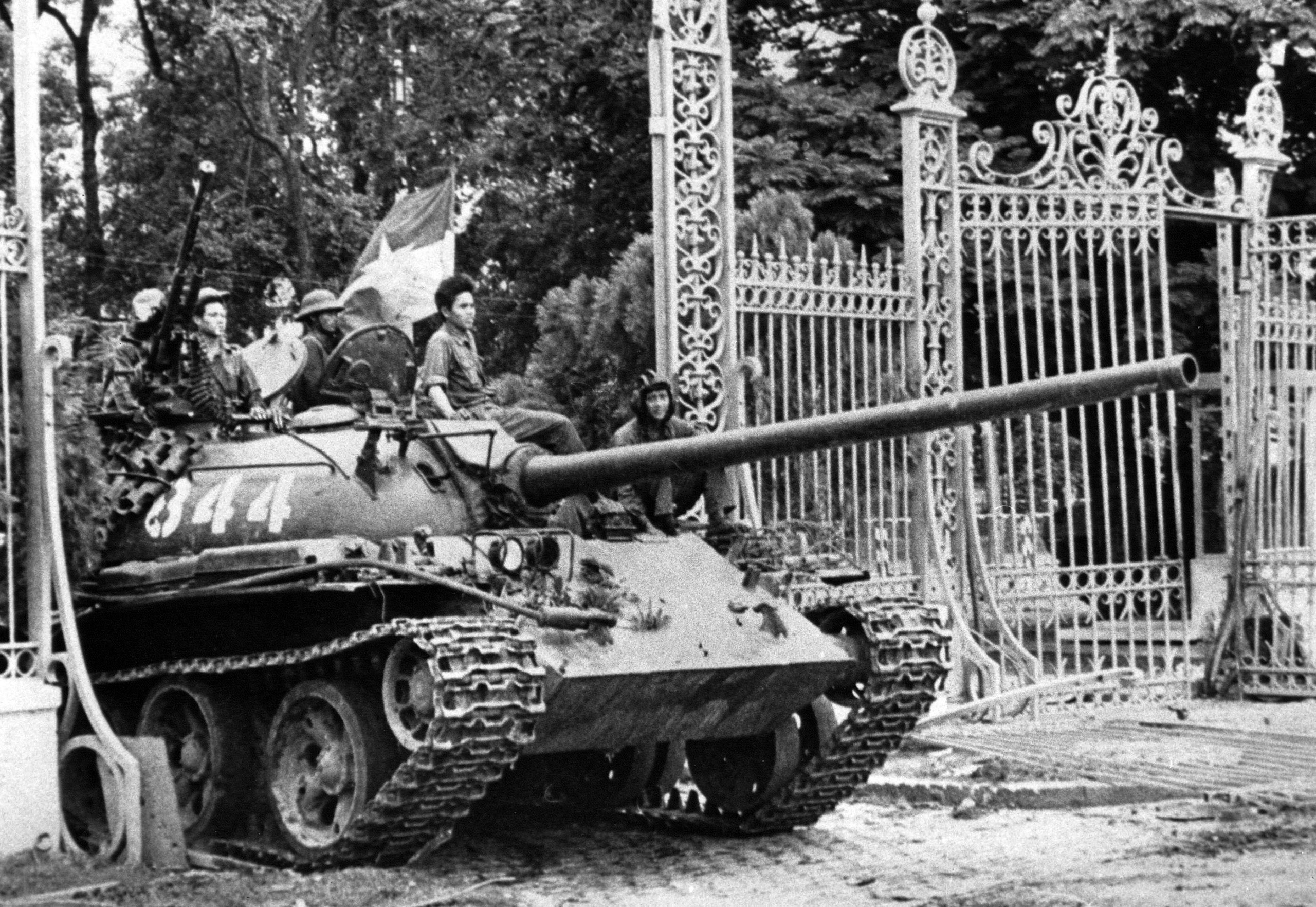 A North Vietnamese tank rolls through the gate of the Presidential Palace in Saigon, signifying the fall of South Vietnam.
