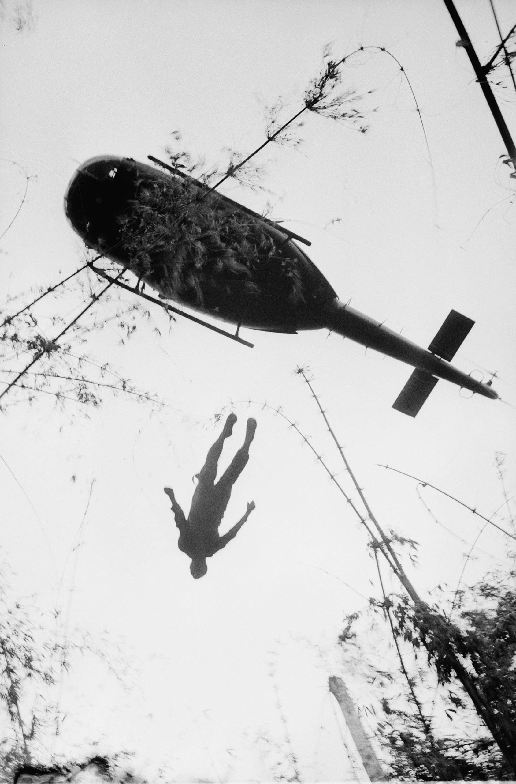 The body of an American paratrooper killed in action in the jungle near the Cambodian border is raised up to an evacuation helicopter in War Zone C in Vietnam on May 14, 1966.