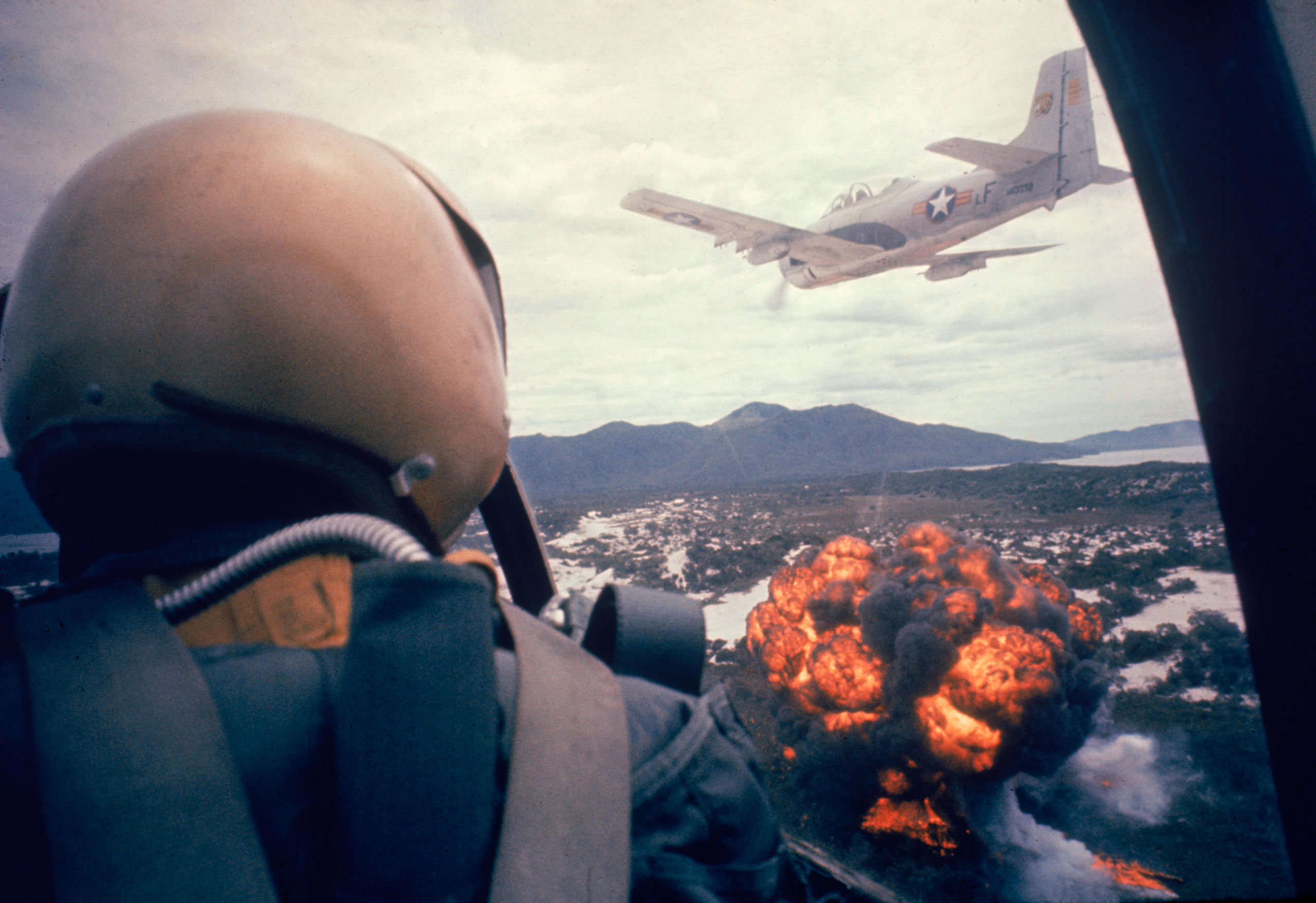 American jets drop napalm on Viet Cong positions early in the Vietnam conflict in 1963.