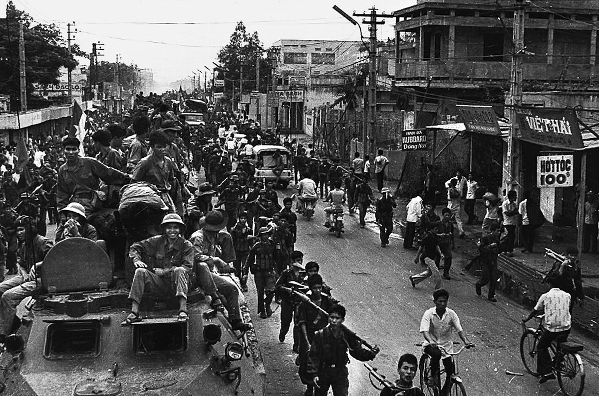 A 30 April 1975 photo shows communist troops on top of trucks and APCs making their way to the center of Saigon