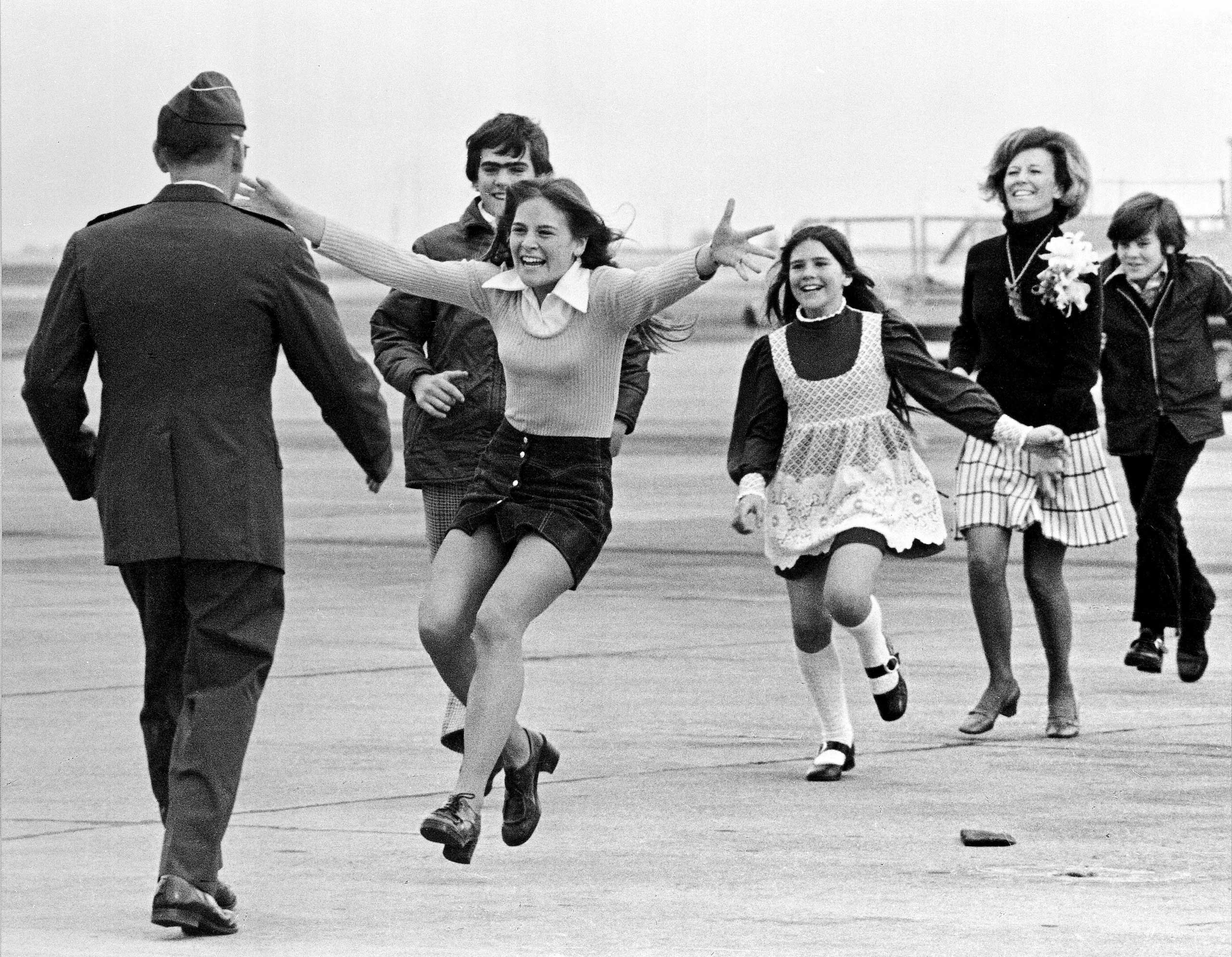 Released prisoner of war Lt. Col. Robert L. Stirm is greeted by his family at Travis Air Force Base in Fairfield, Calif., as he returns home from the Vietnam War on March 17, 1973.