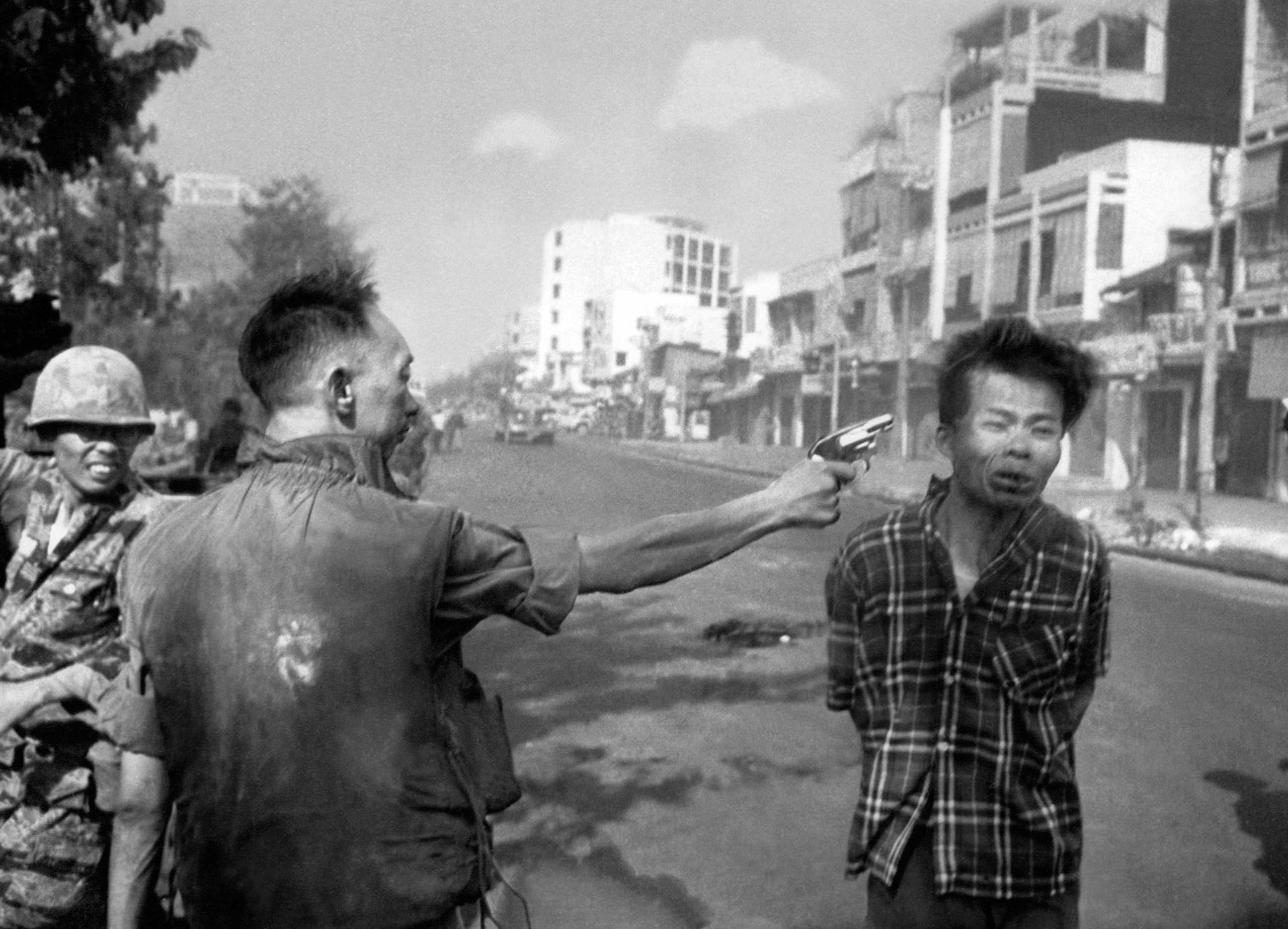 South Vietnamese General Nguyen Ngoc Loan, chief of the National Police, fires his pistol into the head of suspected Viet Cong officer Nguyen Van Lem (also known as Bay Lop) on a Saigon street on Feb. 1, 1968.
