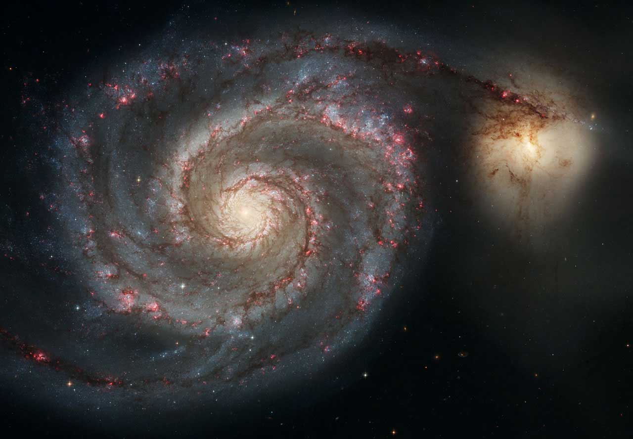 The Whirlpool:                               The arms of the majestic spiral galaxy M51 (NGC 5194) are long lanes of stars and gas laced with dust. This sharpest-ever image illustrates a spiral galaxy's grand design, from its curving spiral arms, where young stars reside, to its yellowish central core, a home of older stars. Image released on April 25, 2005