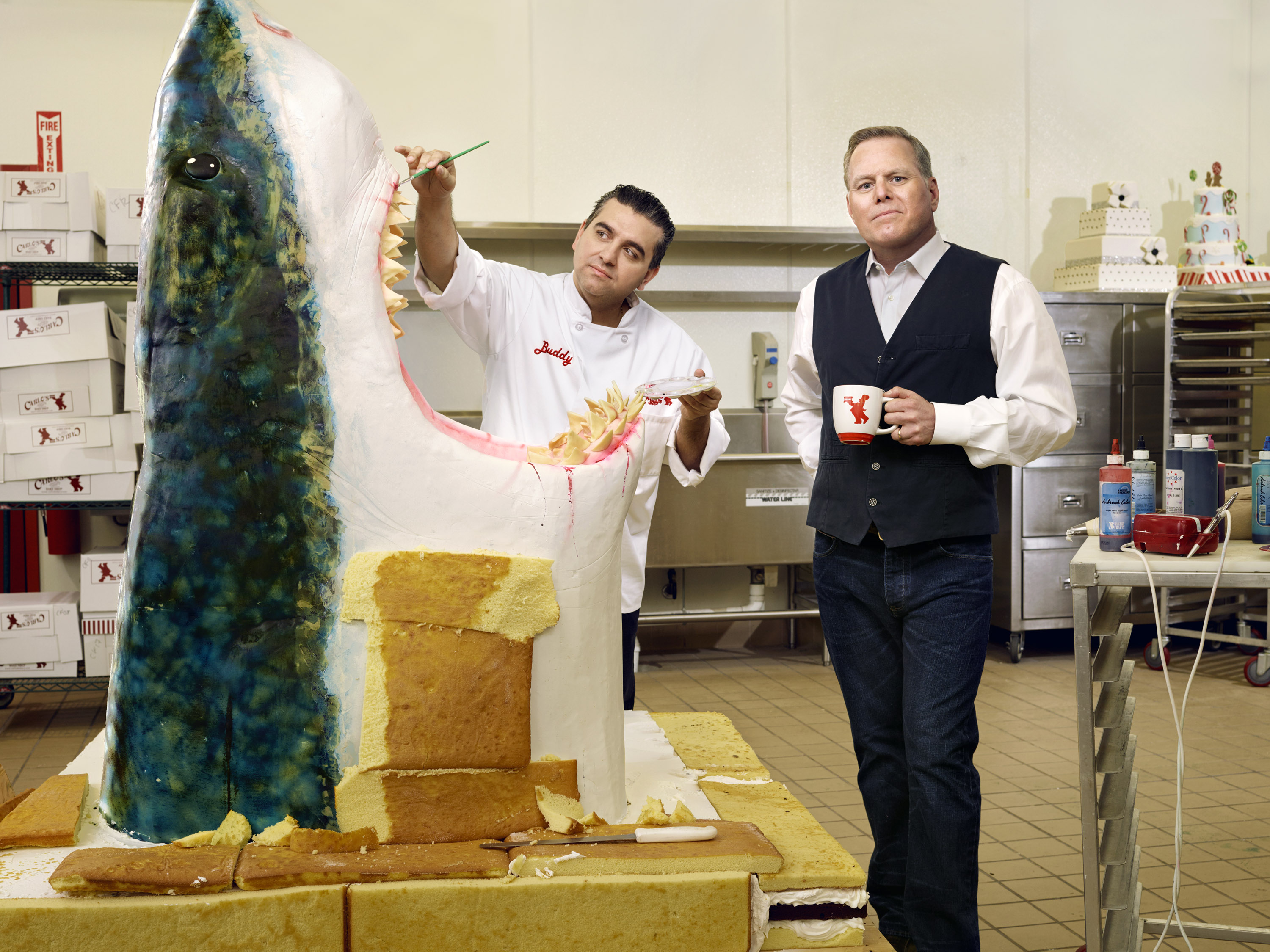 Cake Boss Buddy Valastro, left, and David Zaslav at a Carlo's bakery facility in Jersey City, N.J.
