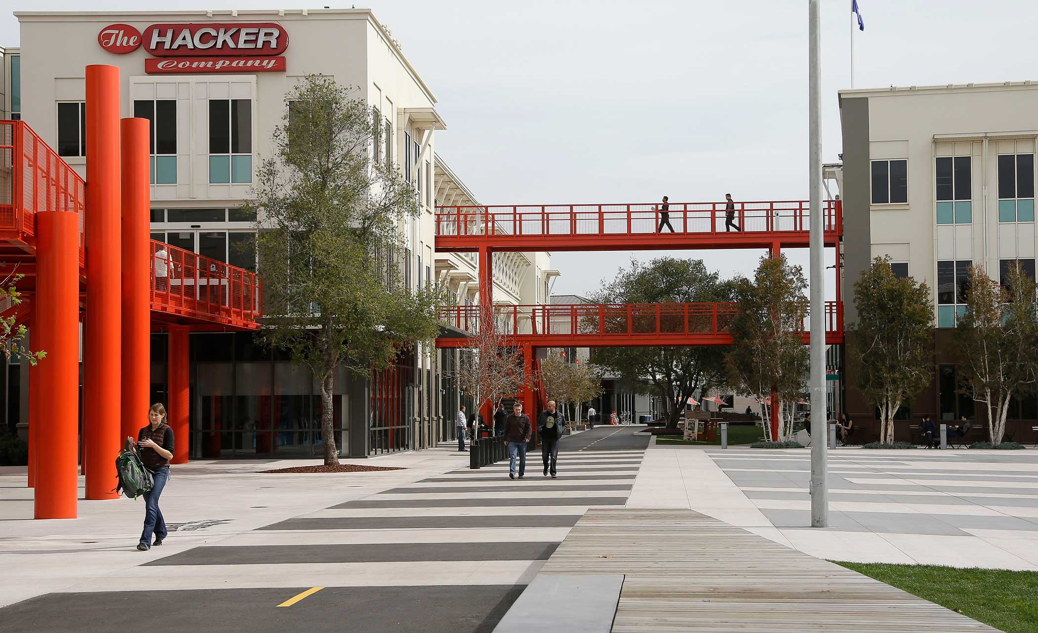 "<strong>Main Headquarters: </strong>Facebook employees are shown on the campus below the famous sign ""The Hacker Company""."