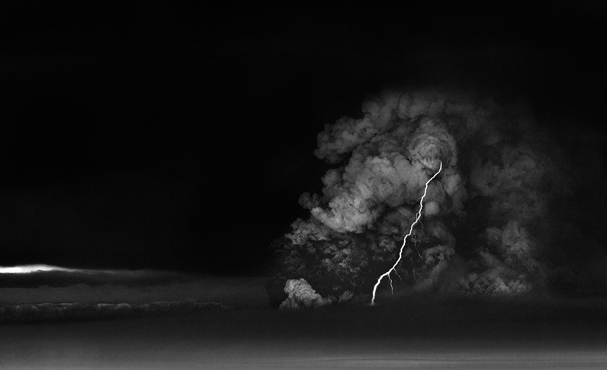 A lightning bolt strikes through an ash cloud erupting from the Grimsvotn volcano in Iceland, May 21, 2011.