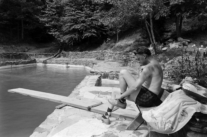 The Rev. Billy Graham beside his swimming pool, 1955.