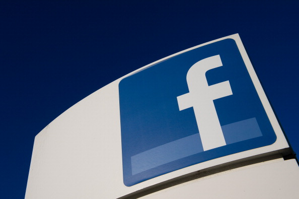 Facebook Inc. signage is displayed outside the company's campus in Menlo Park, Calif.