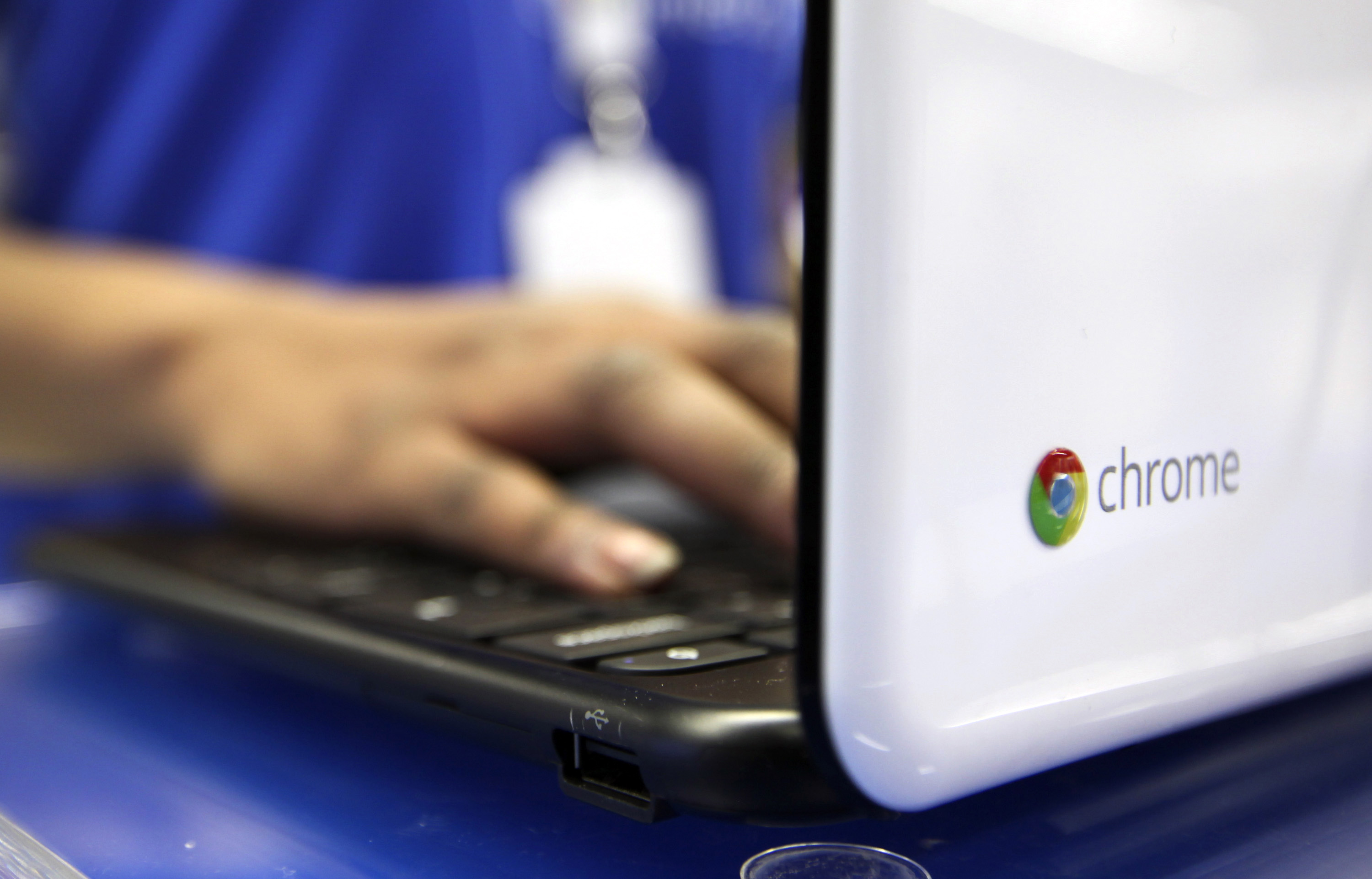 An employee demonstrates a Samsung Electronics Co. Chromebook laptop in the Google Inc. sales area at a Currys and PC World 2 in 1 store, operated by Dixons Retail Plc, on Tottenham Court Road in London, U.K.