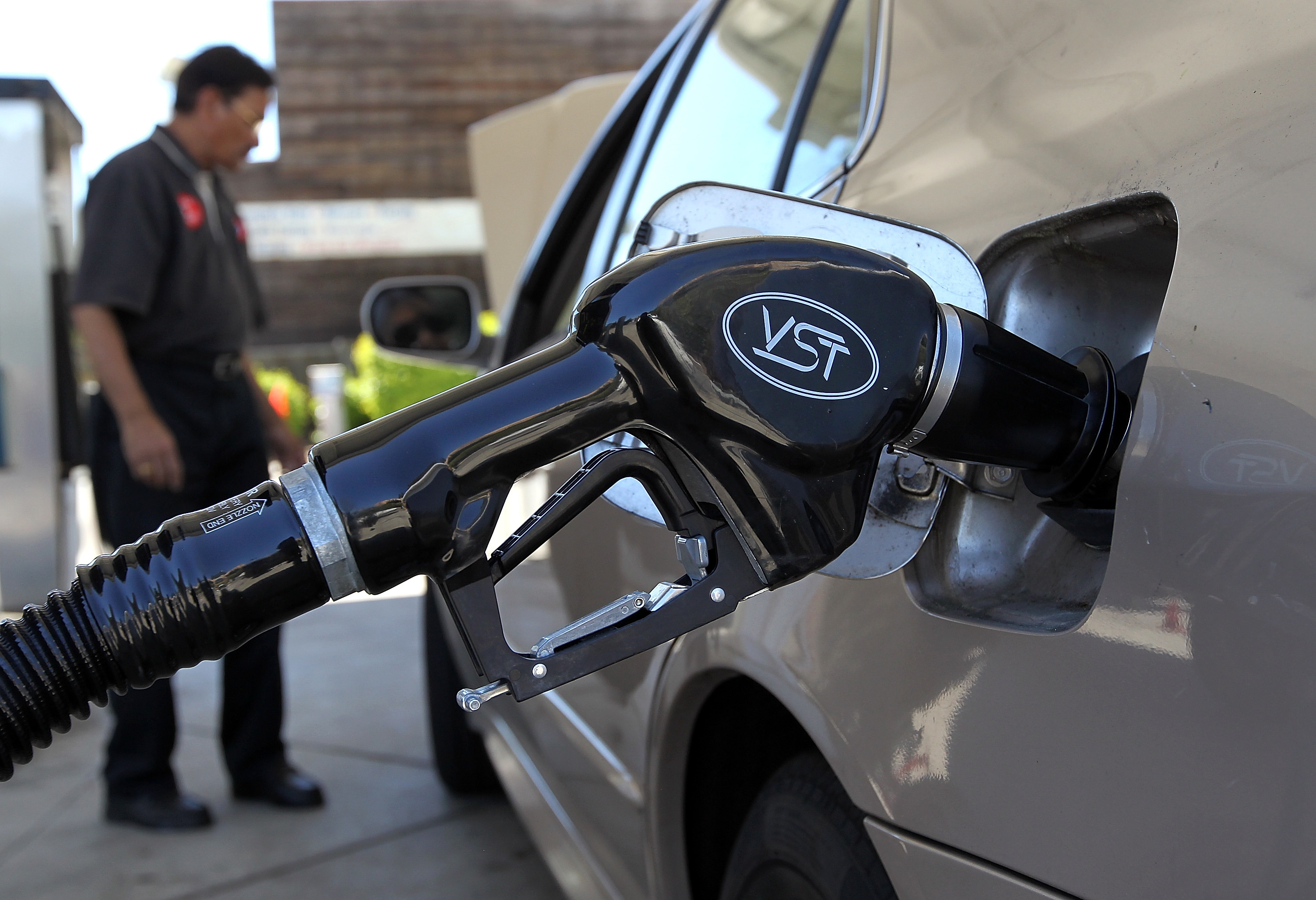 A gasoline pump rests in the tank of a car on June 12, 2012 in San Anselmo, California.