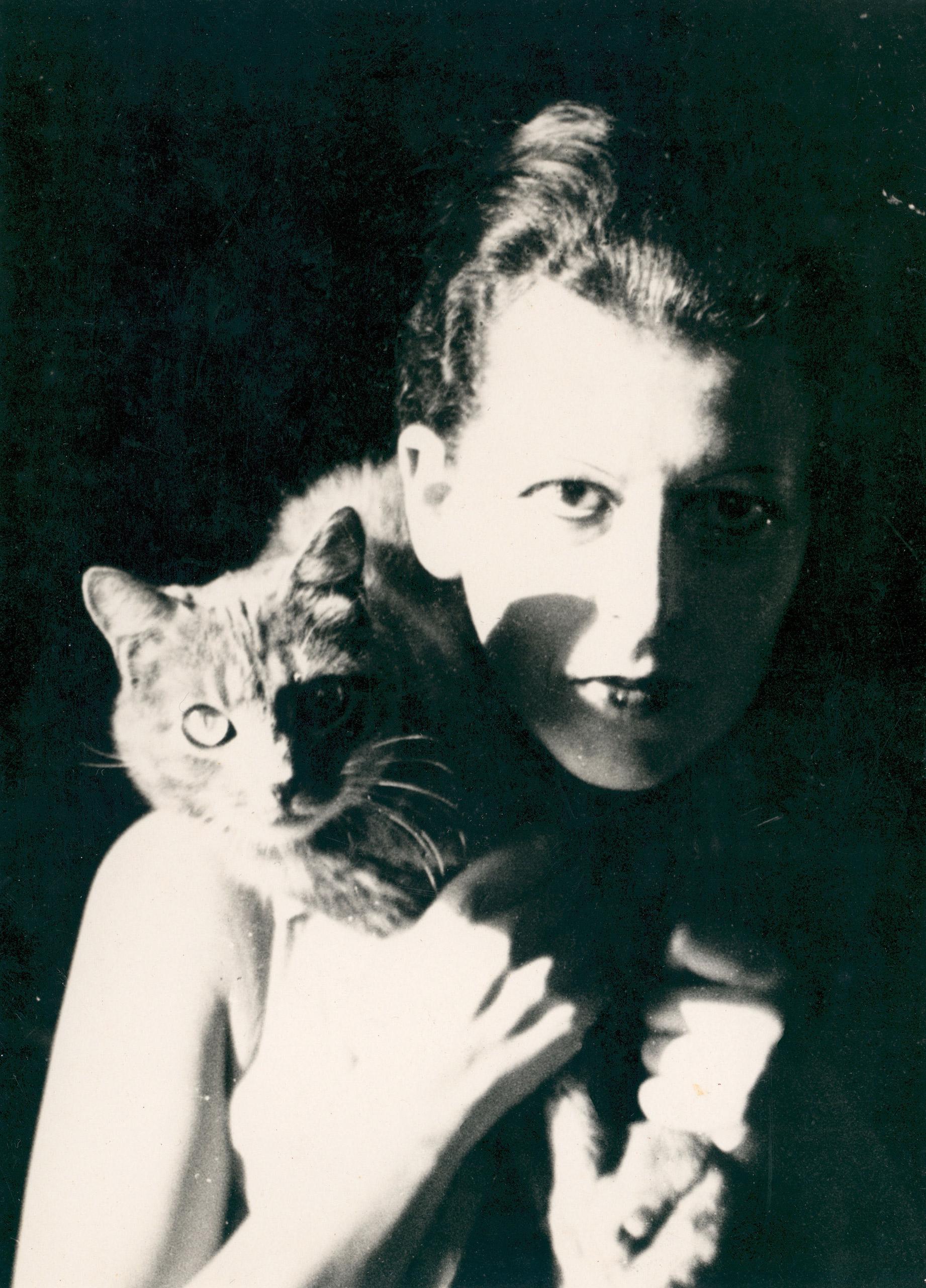 Artist Claude Cahun her cat., 1927.
