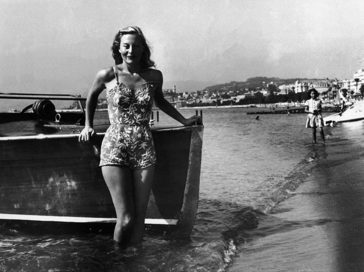 French Actress Michele Morgan poses in a bathing suit at the 1st Cannes Film Festival in Cannes, France in 1946.