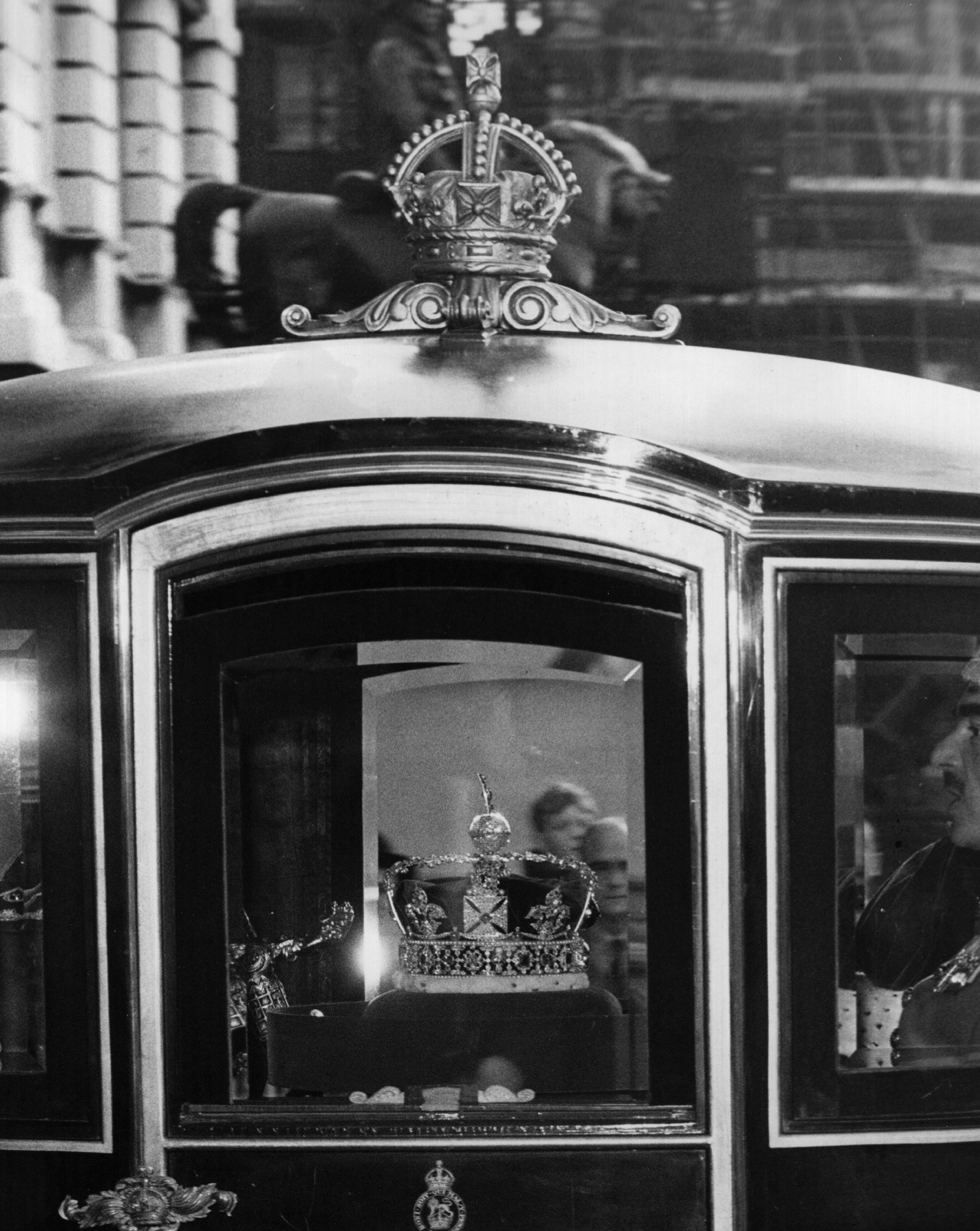 The Imperial State Crown lit by special spot lights in the Queen Alexandra's State Carriage as it precedes the Queen on her way to the State Opening of Parliament, in 1962.