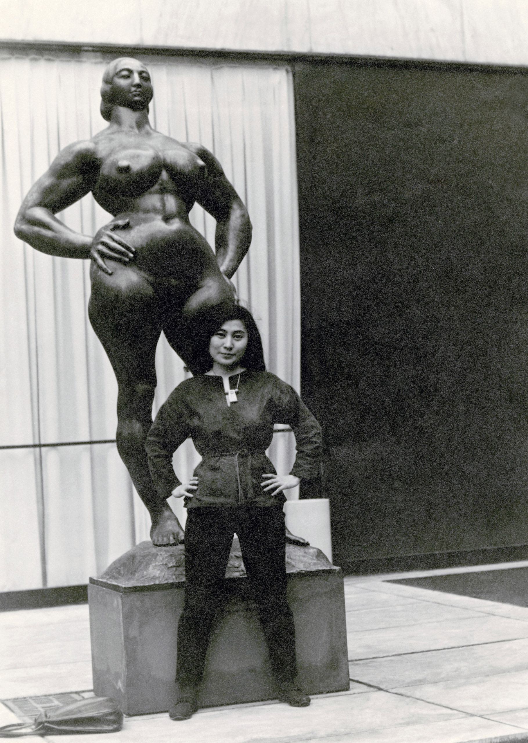 Yoko Ono with Standing Woman (1932) by Gaston Lachaise, The Museum of Modern Art Sculpture Garden, New York. c. 1960–61.