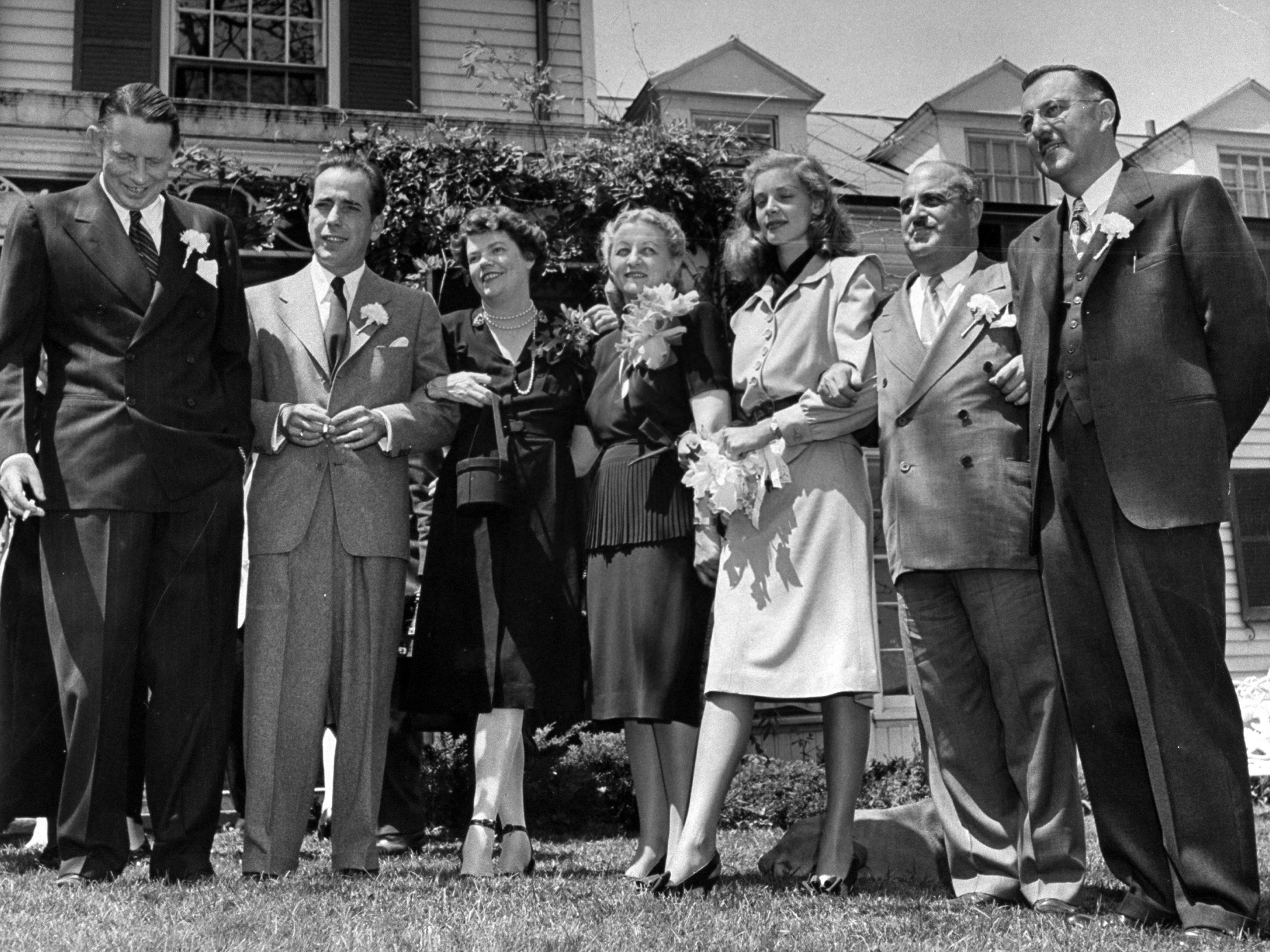 Novelist Louis Bromfield (L) with Humphrey Bogart, Lauren Bacall and their guests at their wedding.