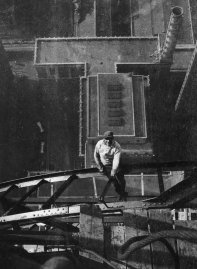 High-angle view of a worker sitting on a steel girder high atop the Chrysler Building, on the 54th floor, during its construction, New York City, 1929.