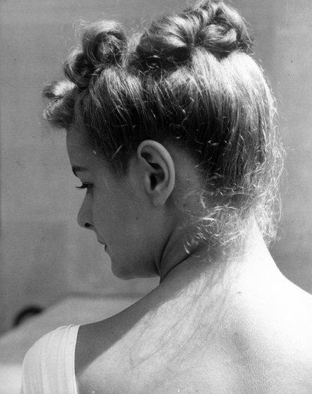Detail of model June Cox's hair.
